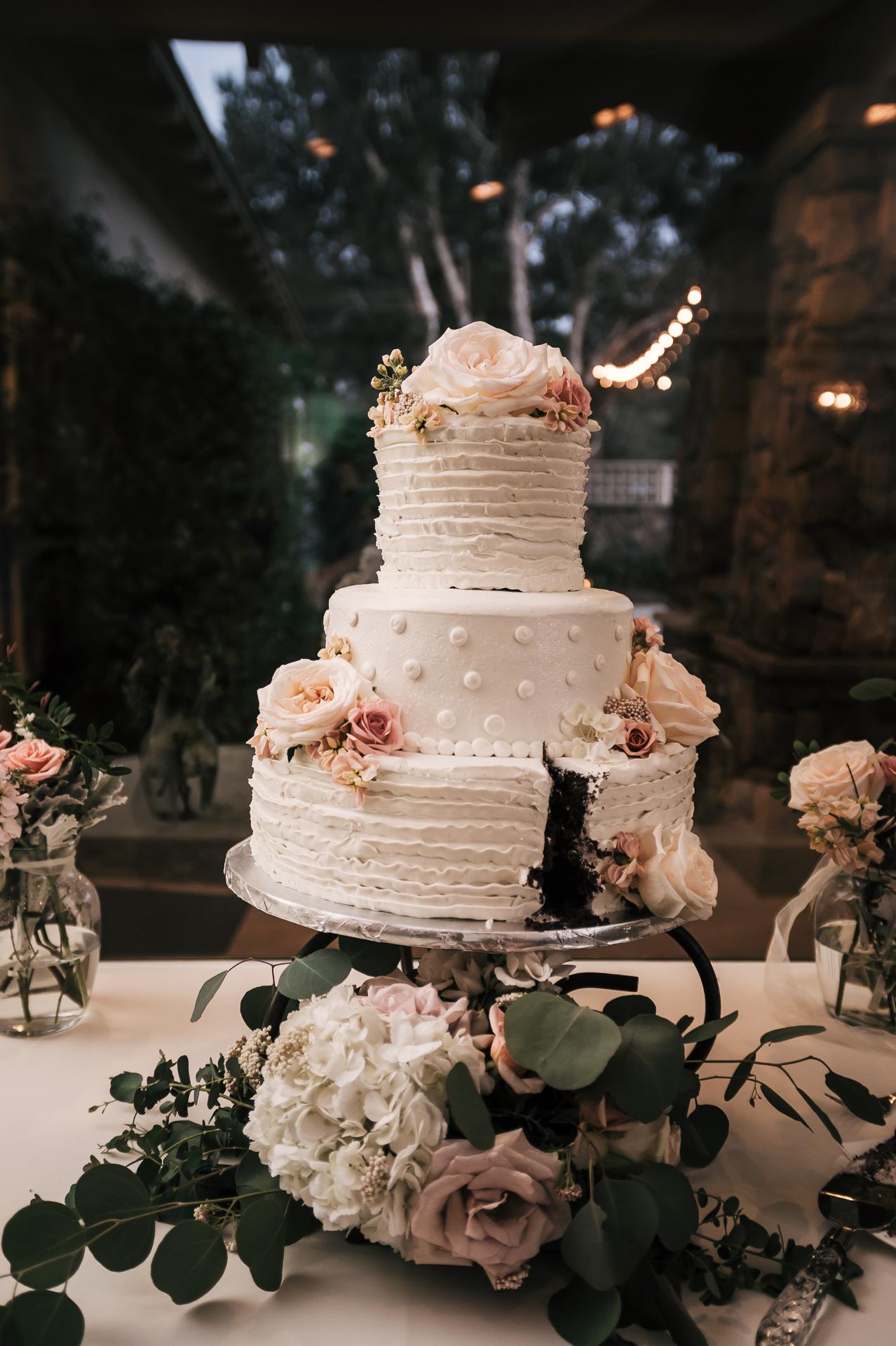 beautiful wedding cake after caek cutting at the Twin Oaks Golf Course in San Marcos, San Diegos premier wedding venue