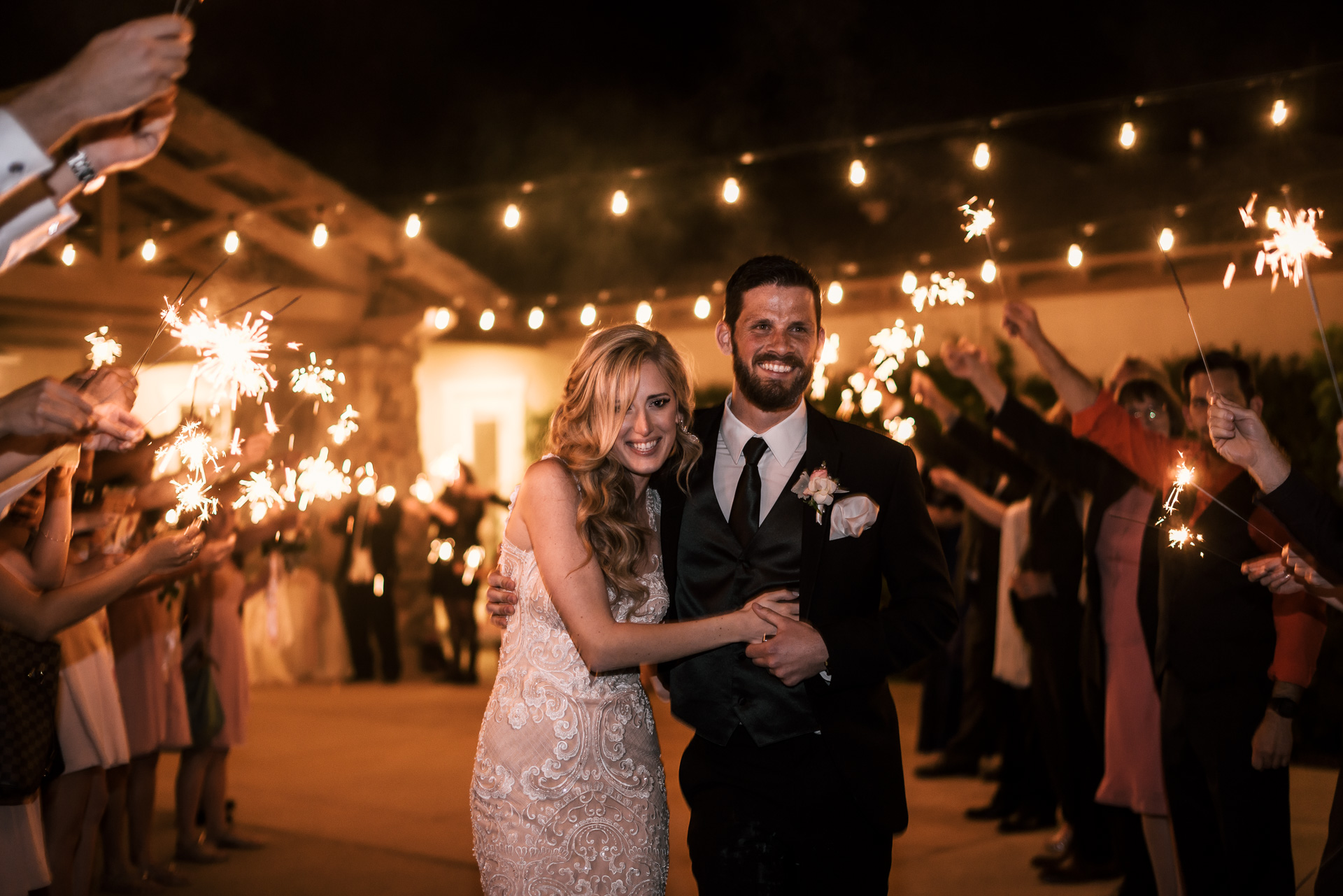bride and groom make their grand exit at the Twin Oaks Golf Course in San Marcos, San Diegos premier wedding venue