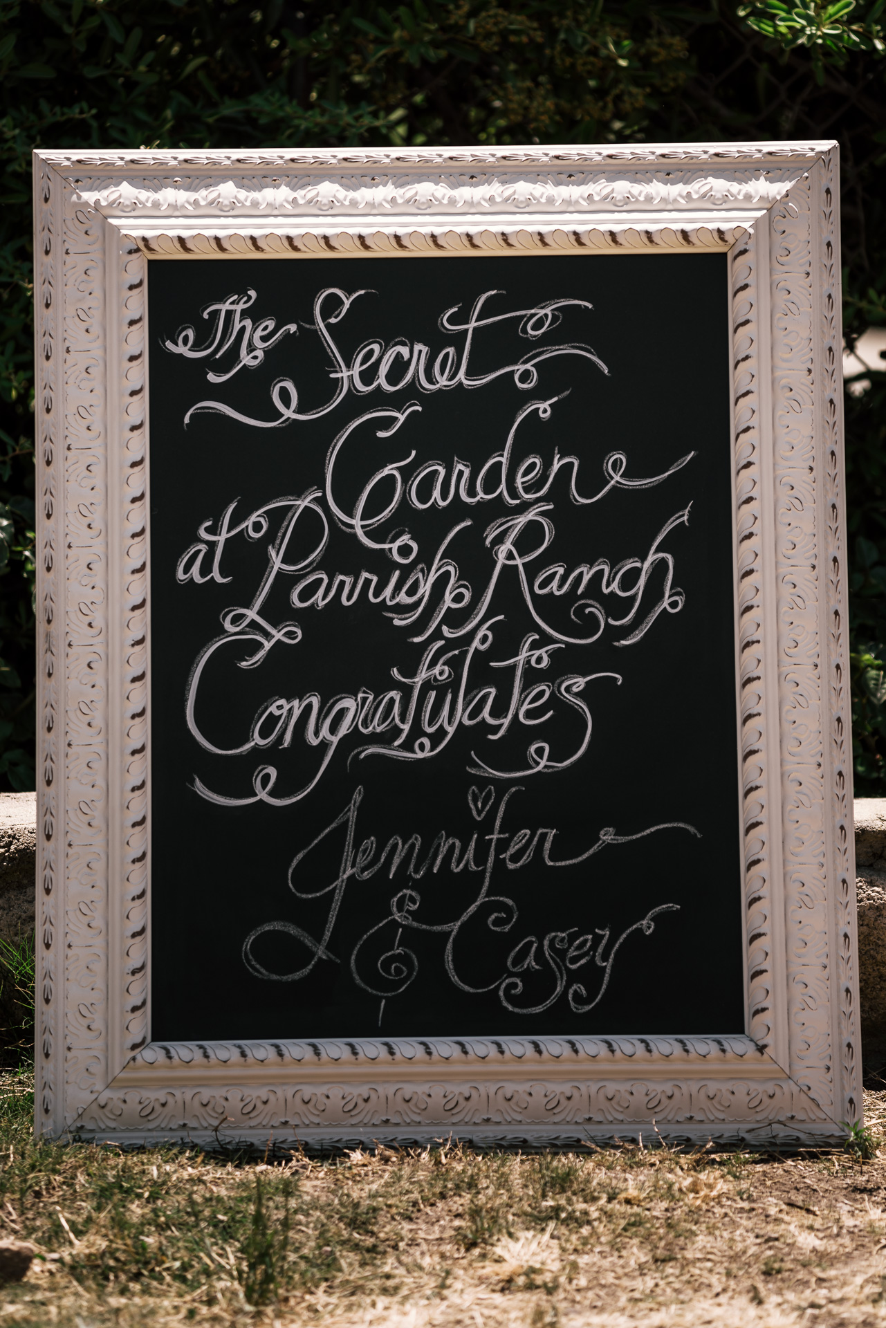 chalk wedding sign at the secret garden located at the Historic Parish ranch in Oak Glen California