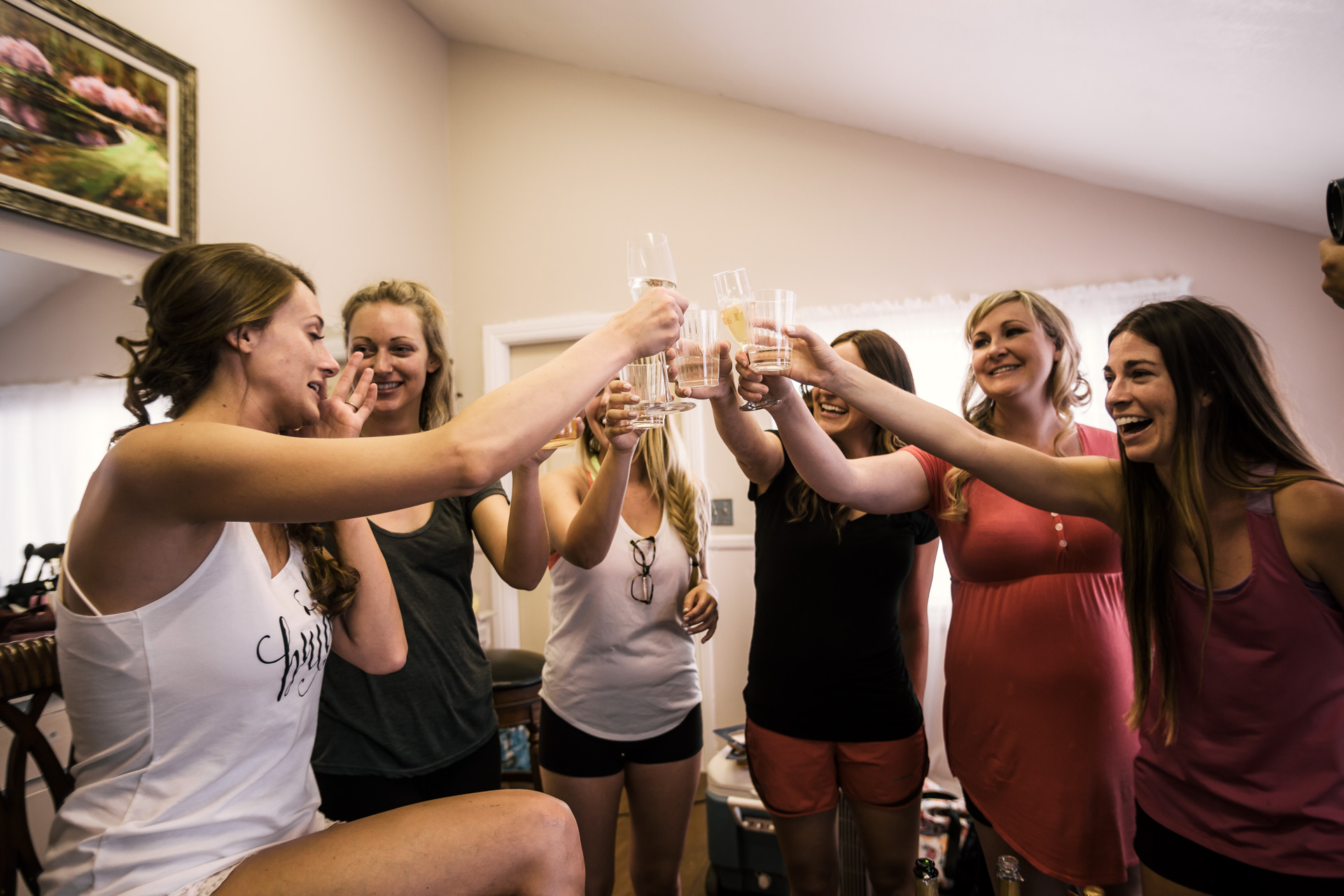 bride has a drink with her bridesmaids at the secret garden located at the Historic Parish ranch in Oak Glen California
