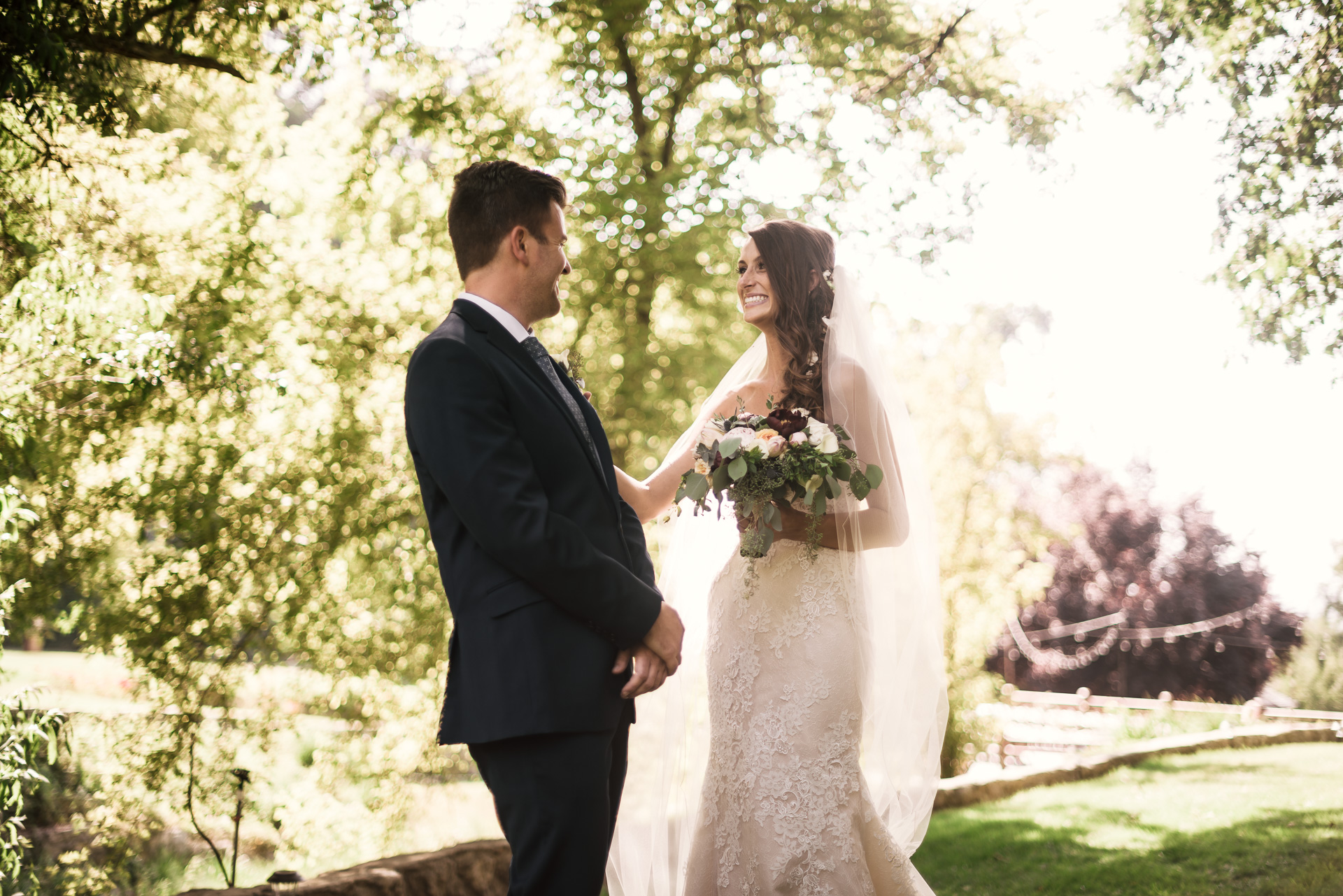 bride and groom see each other for the first time at the secret garden located at the Historic Parish ranch in Oak Glen California