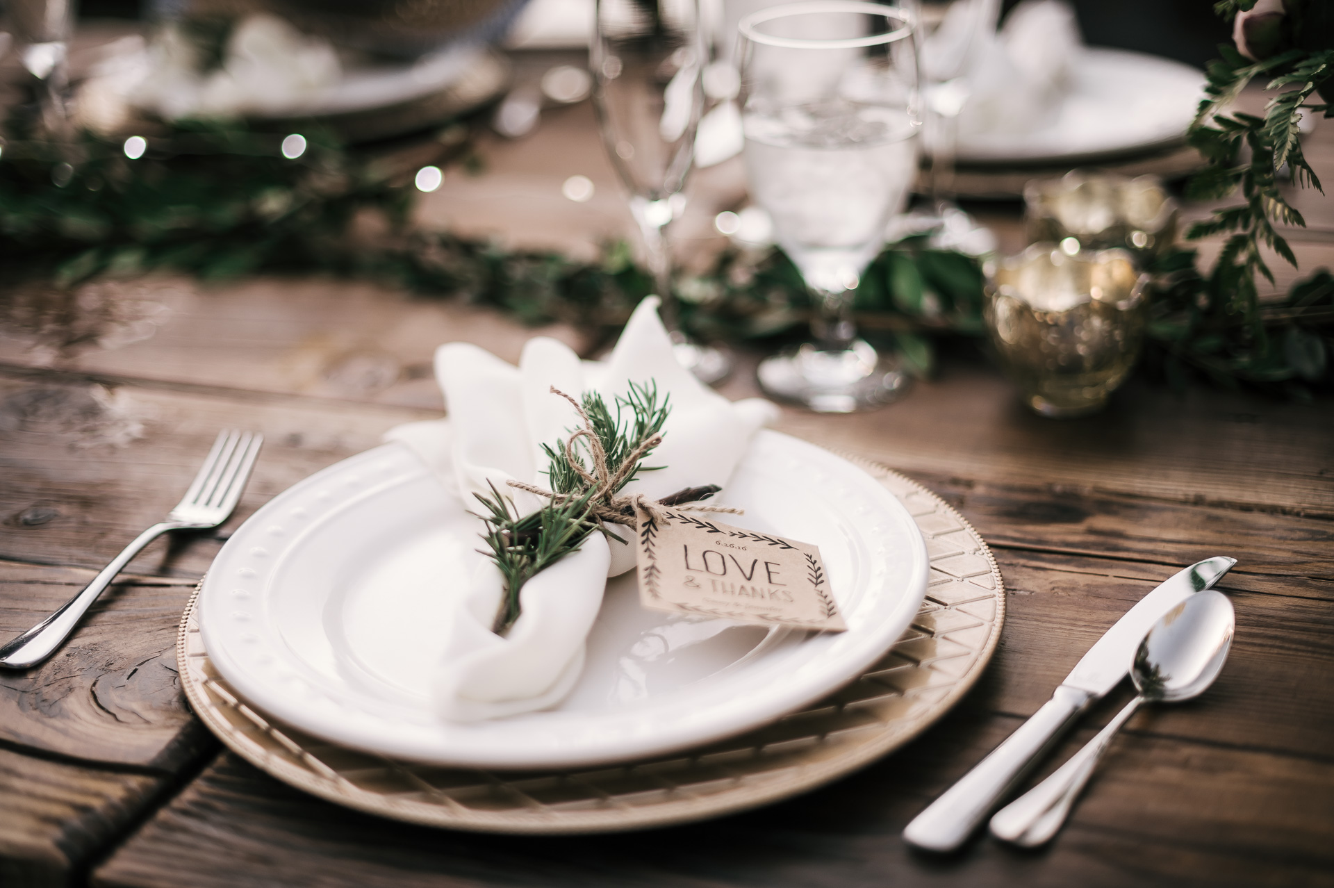 beautiful rustic wedding place settings on tables at the secret garden located at the Historic Parish ranch in Oak Glen California