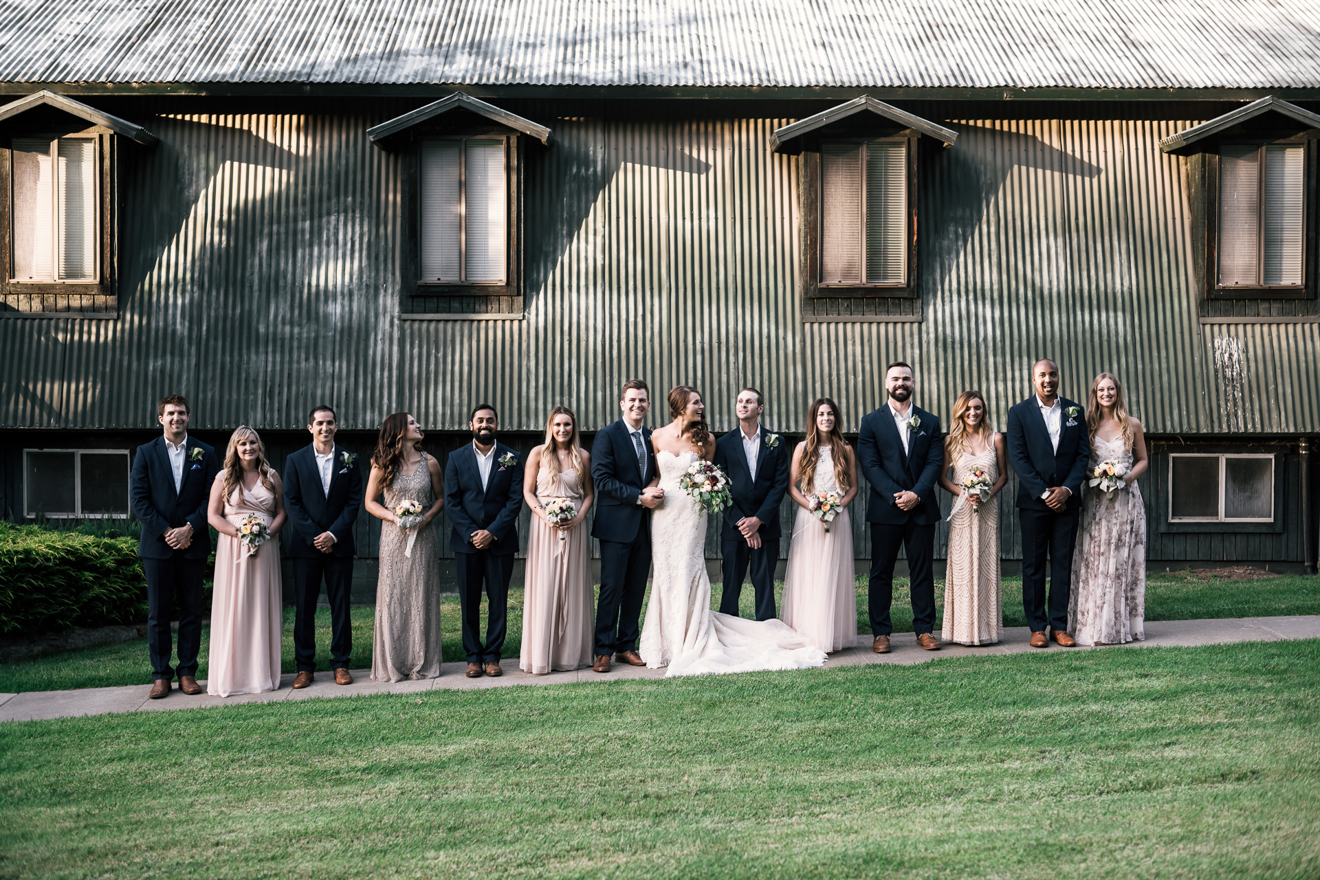 bridal party lines up for photos at the secret garden located at the Historic Parish ranch in Oak Glen California