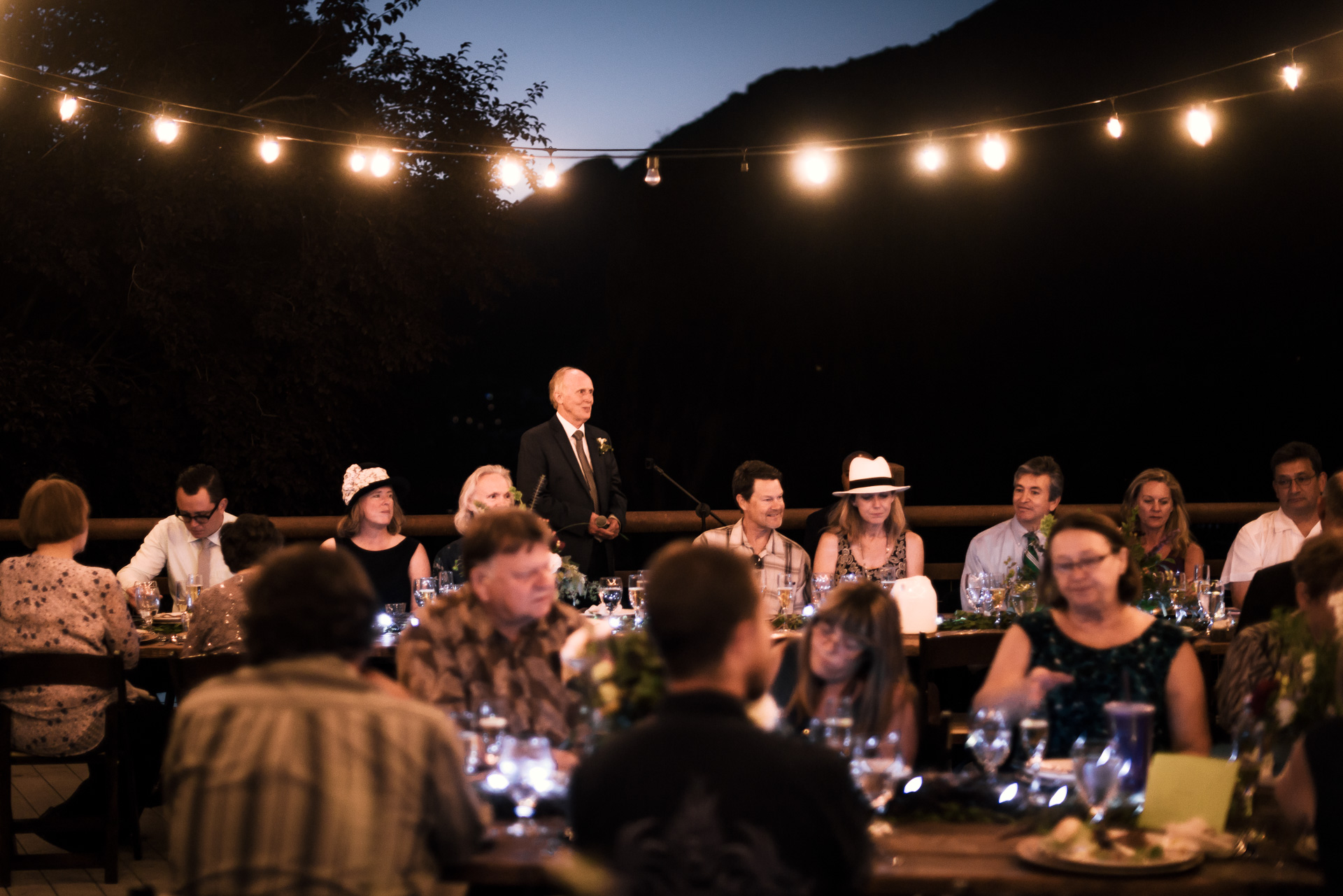 father of the bride makes a toast at the secret garden located at the Historic Parish ranch in Oak Glen California