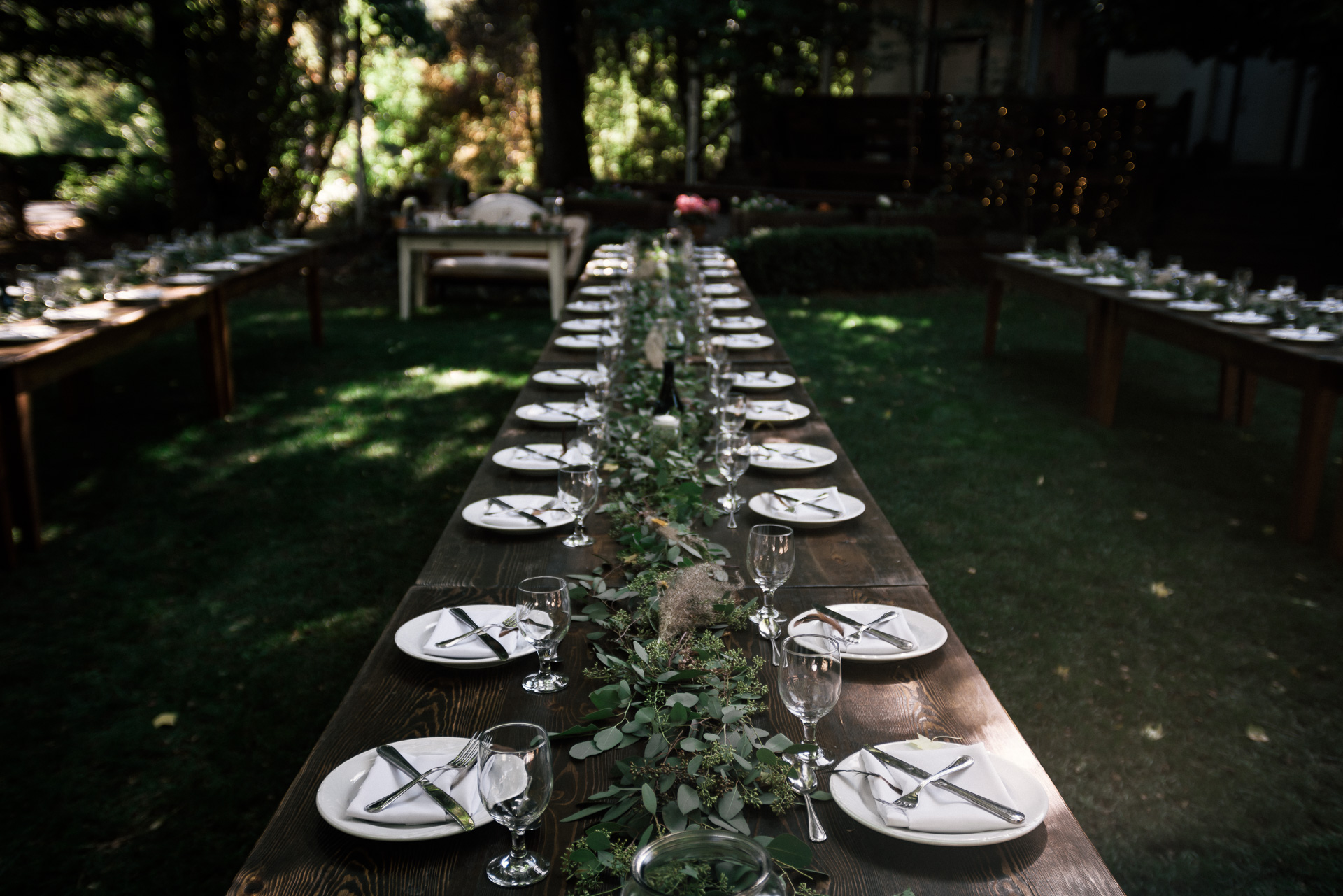 rustic table settings with feathers and eucalyptus shot by wedding photographer at the charming St. George Hotel in Volcano California