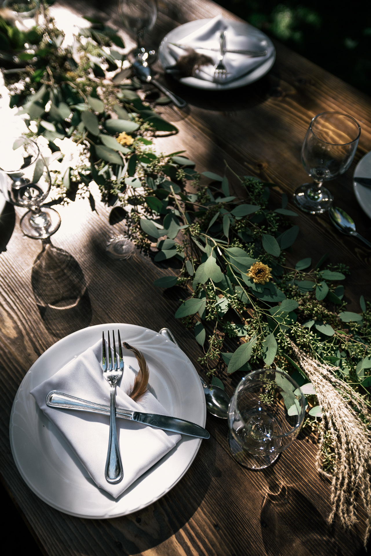 charming table decorations with flowers and eucalyptus shot by wedding photographer at the charming St. George Hotel in Volcano California