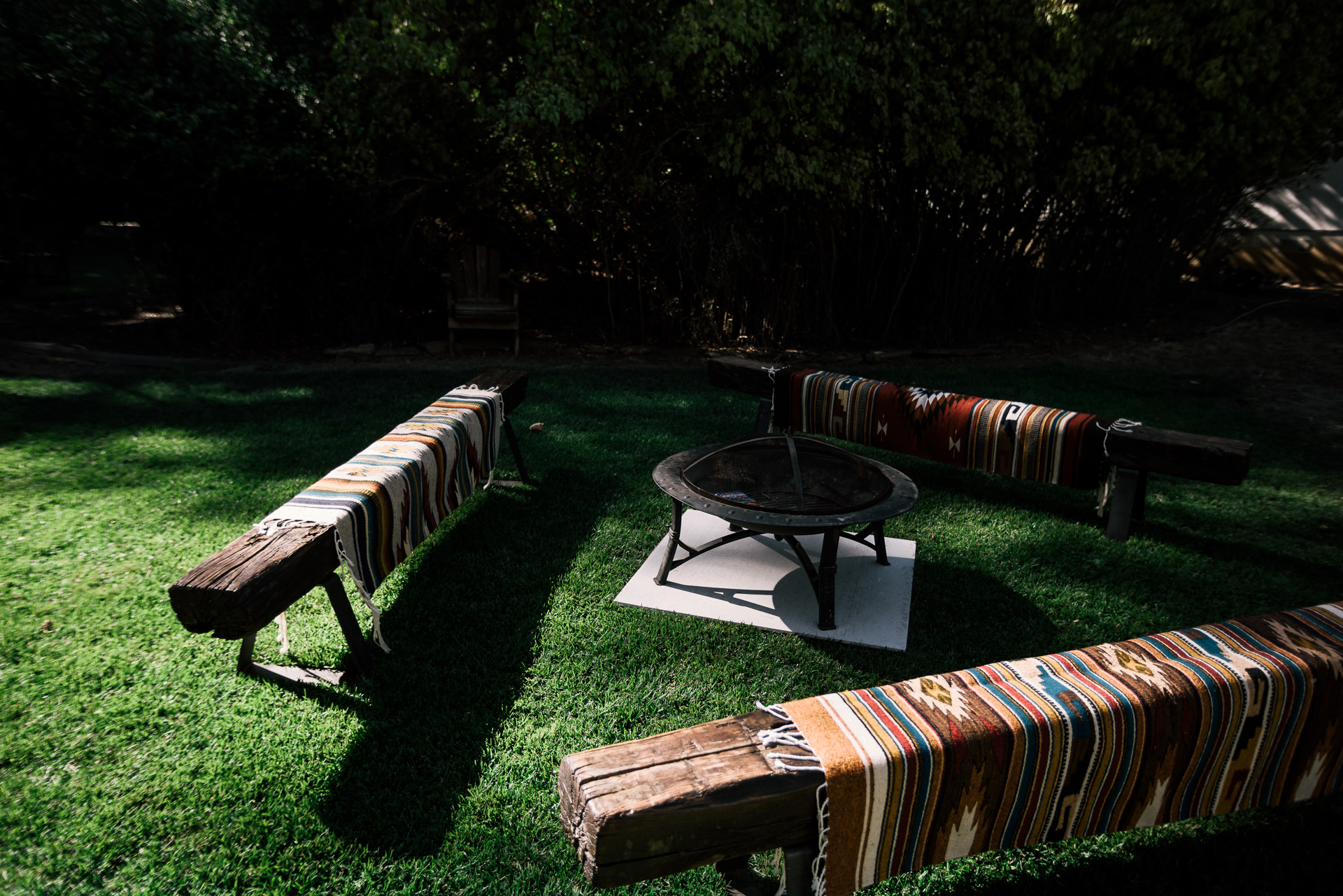 railroad tie benches around a firepit rustic decor shot by wedding photographer at the charming St. George Hotel in Volcano California