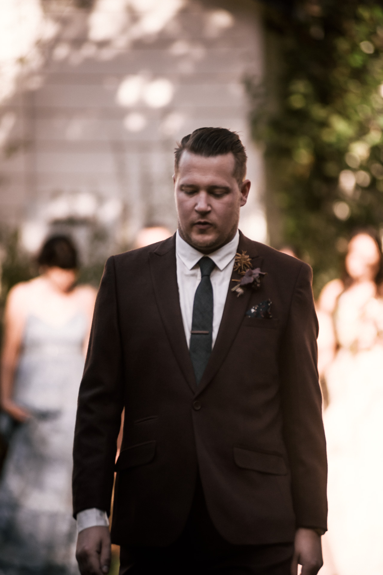 groomsmen walking down the aisle shot by wedding photographer at the charming St. George Hotel in Volcano California