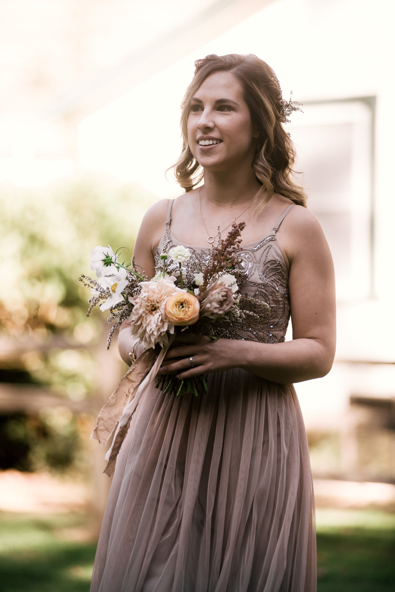 bridesmaid walks down the aisle shot by wedding photographer at the charming St. George Hotel in Volcano California