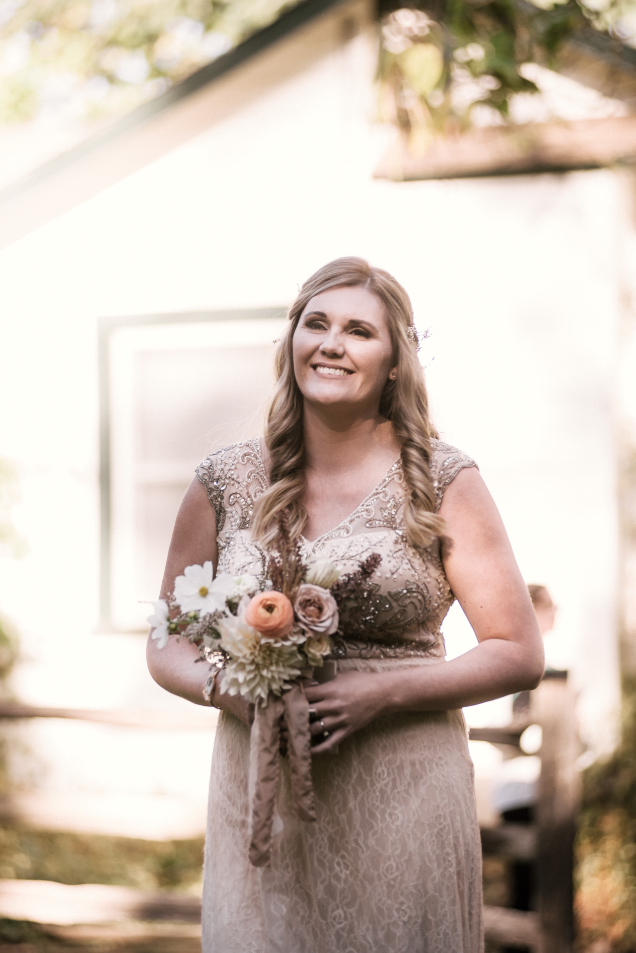 sister of the bride and maid of honor walks down the aisle shot by wedding photographer at the charming St. George Hotel in Volcano California