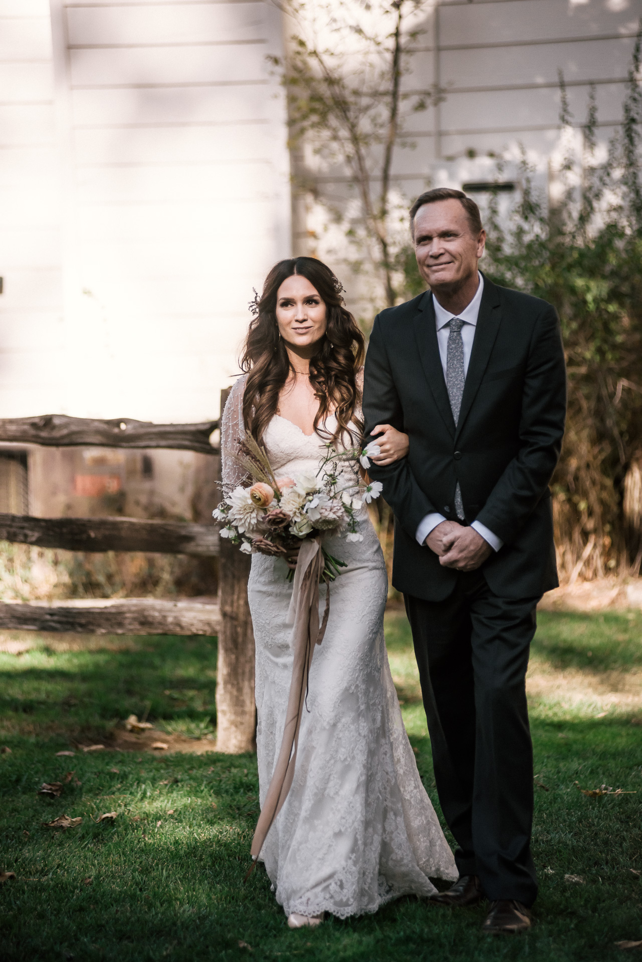 father walks bride down the aisle shot by wedding photographer at the charming St. George Hotel in Volcano California
