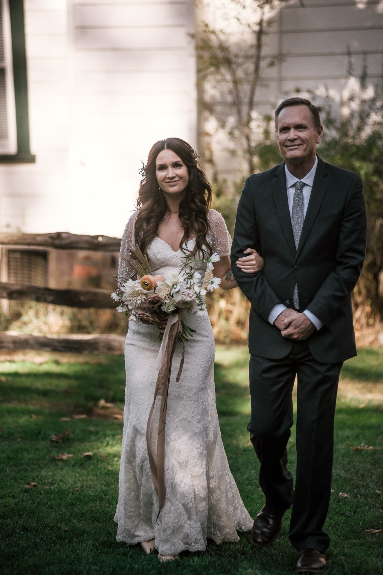 father and daughter head to wedding ceremony shot by wedding photographer at the charming St. George Hotel in Volcano California