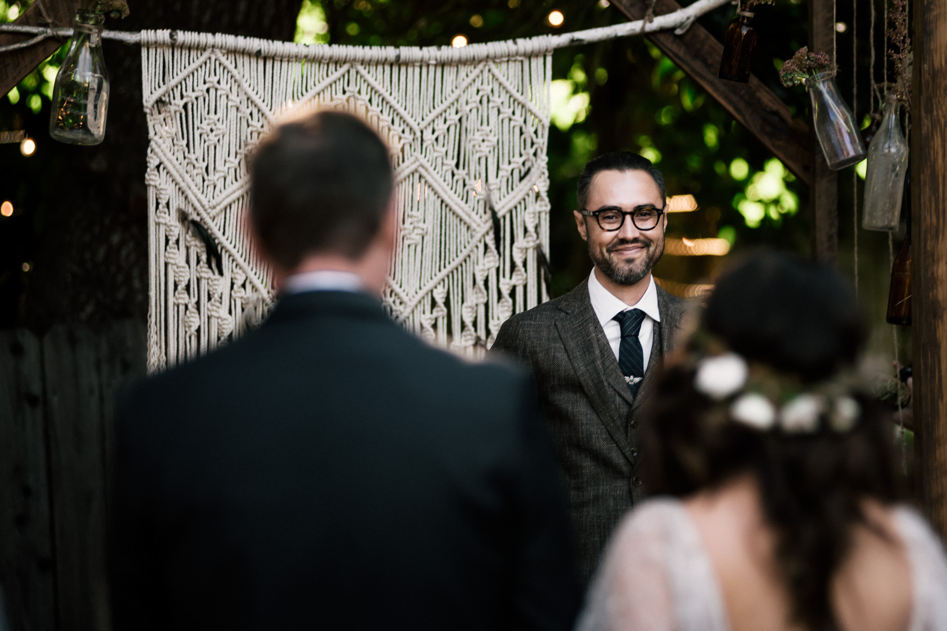 groom sees his bride for the first time shot by wedding photographer at the charming St. George Hotel in Volcano California