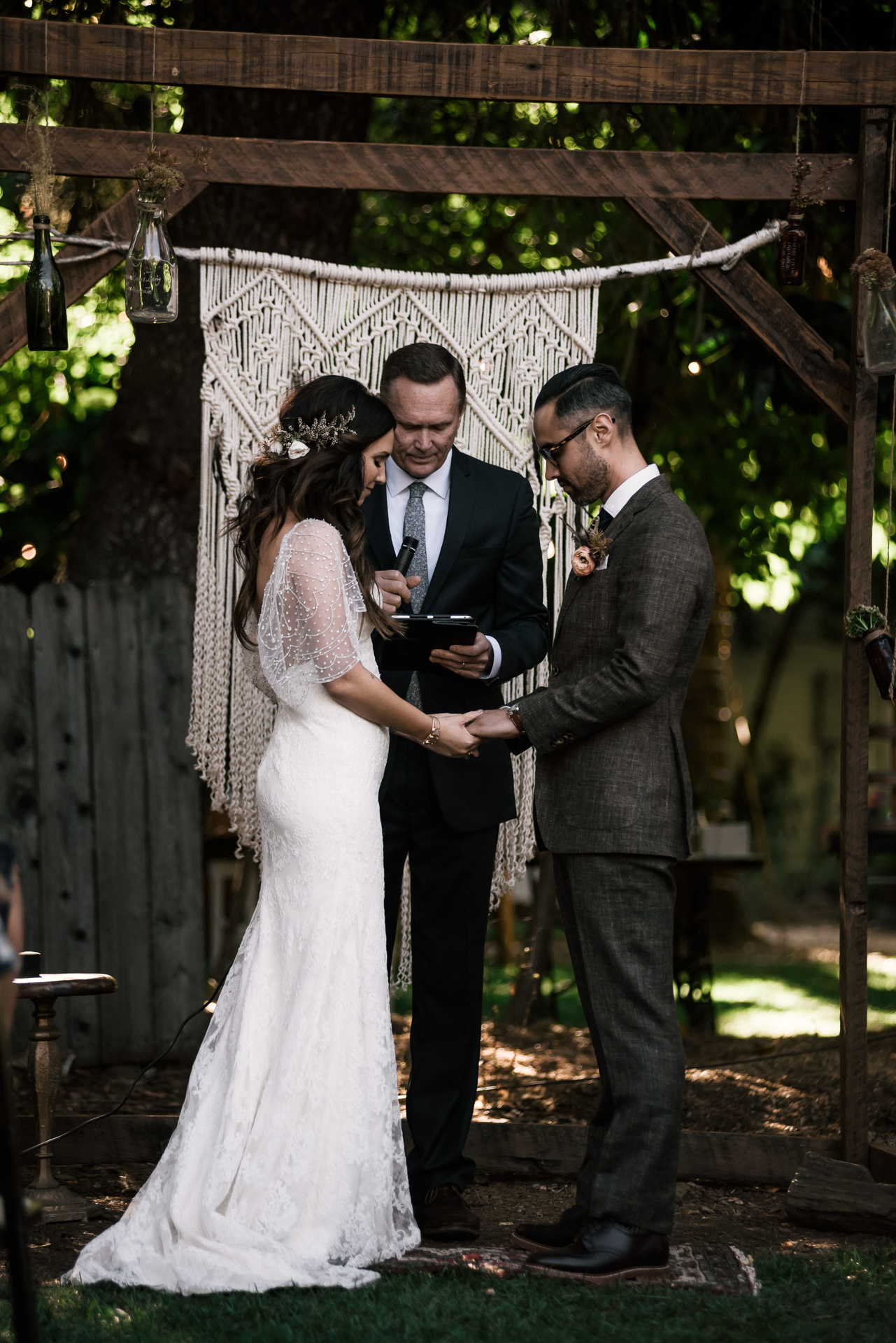 bride and groom say a prayer before the ceremony shot by wedding photographer at the charming St. George Hotel in Volcano California