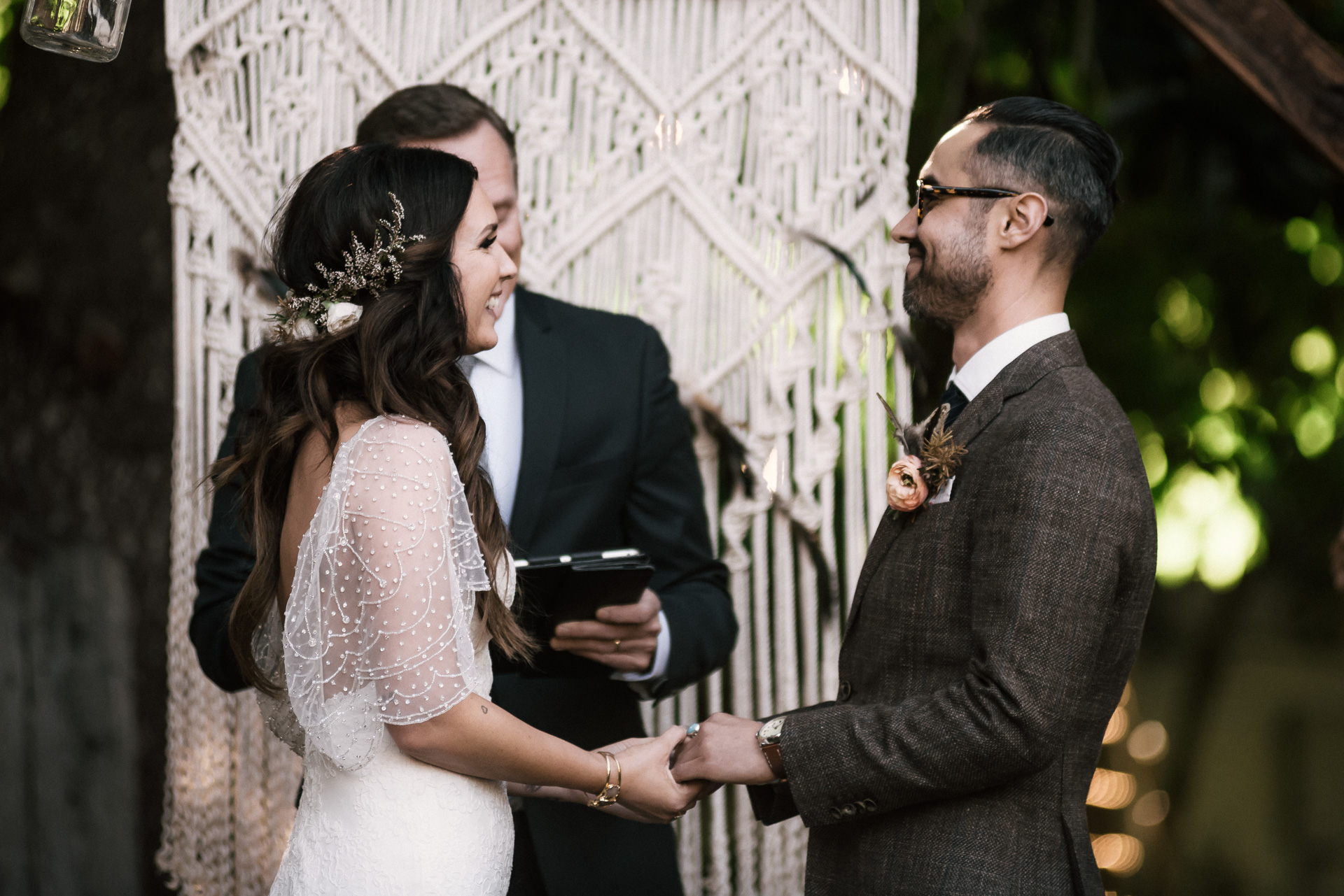 bride smiles at her groom shot by wedding photographer at the charming St. George Hotel in Volcano California