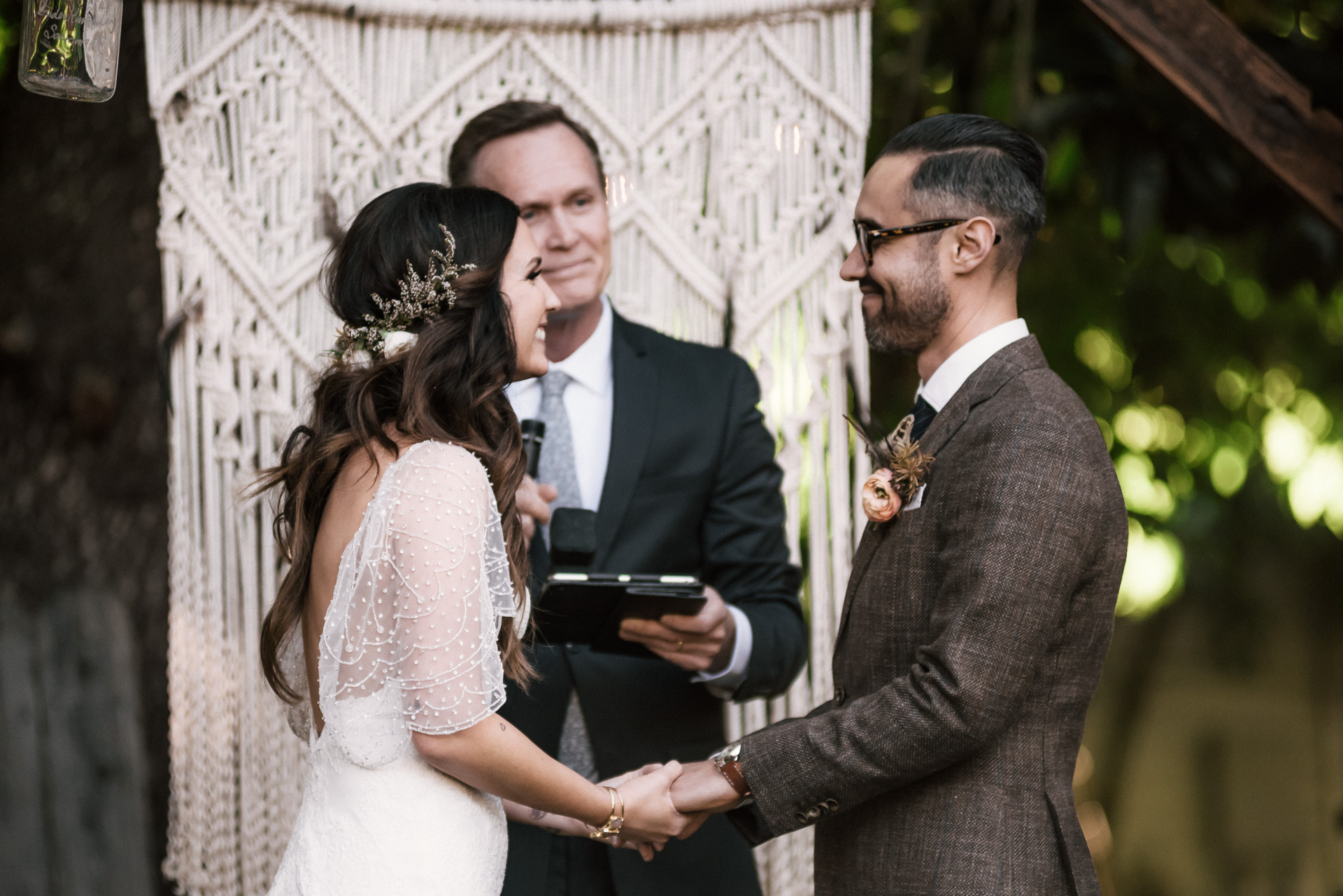 bride and groom share a sweet moment shot by wedding photographer at the charming St. George Hotel in Volcano California