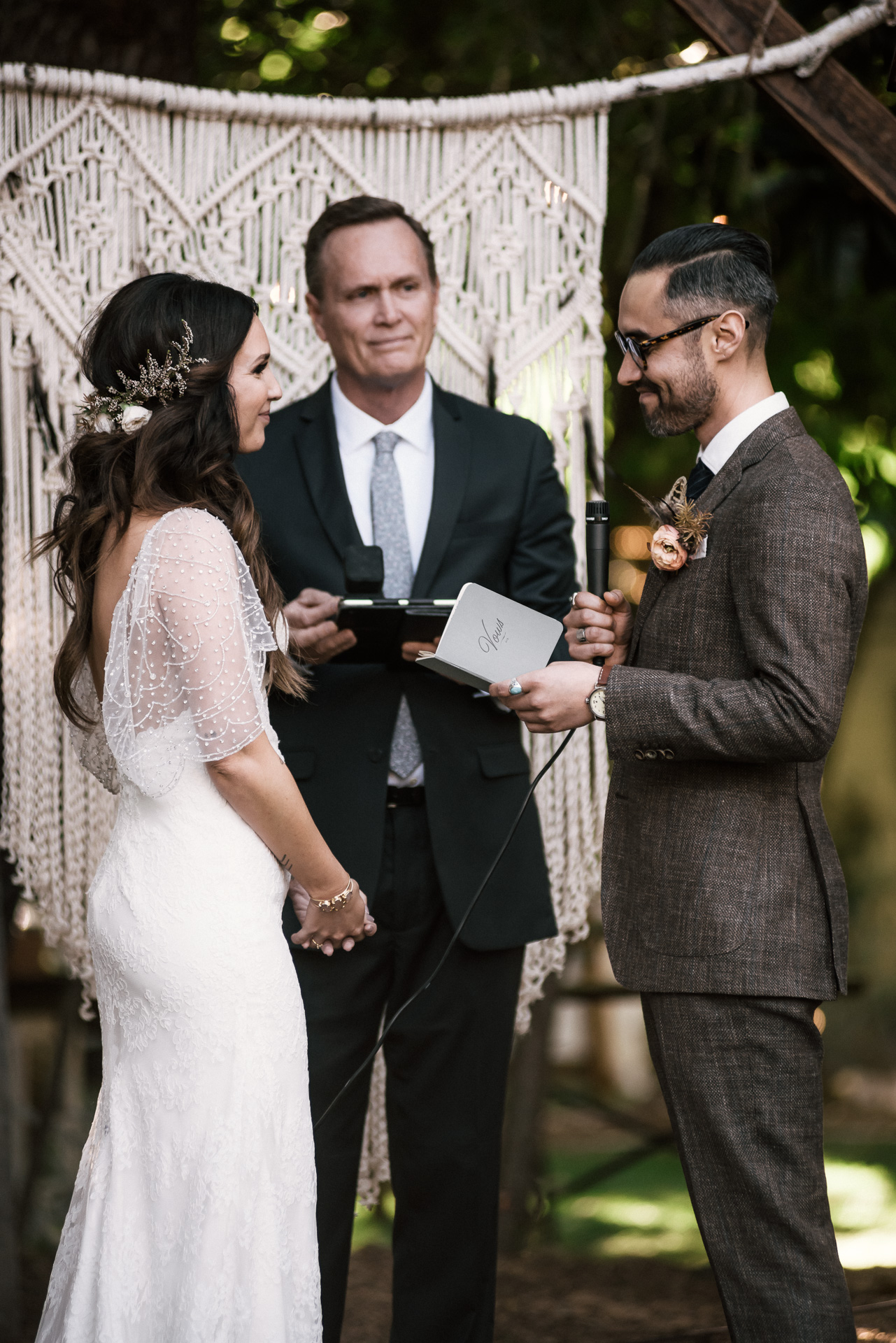 bride listens intently to her grooms vows shot by wedding photographer at the charming St. George Hotel in Volcano California