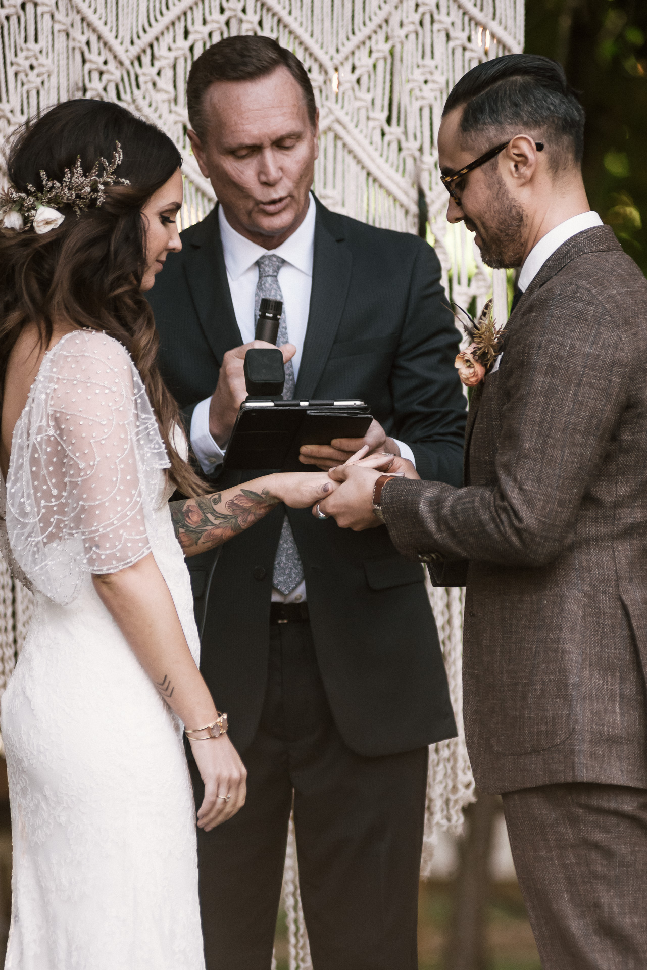 bride recieves her wedding ring shot by wedding photographer at the charming St. George Hotel in Volcano California
