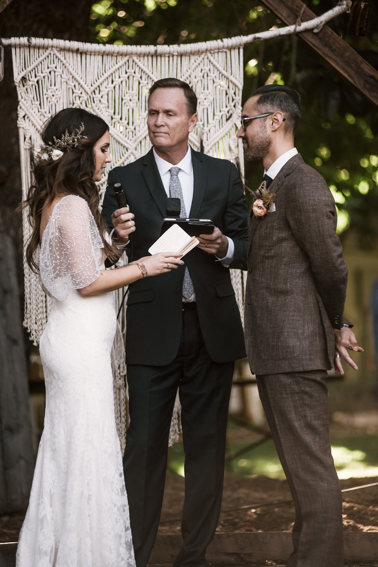 bride reads her vows to the groom shot by wedding photographer at the charming St. George Hotel in Volcano California