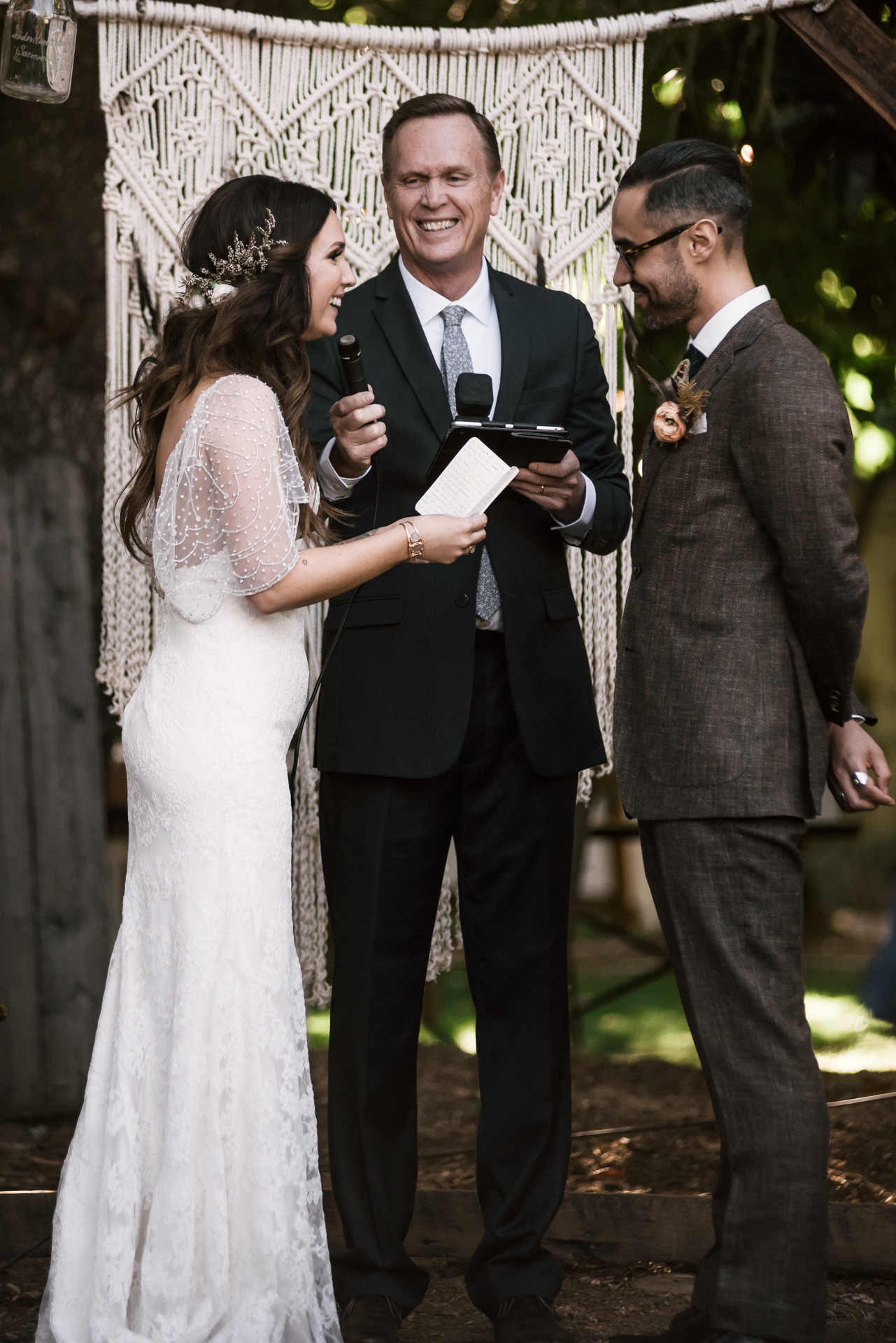 couple smiles as they read thier vows shot by wedding photographer at the charming St. George Hotel in Volcano California