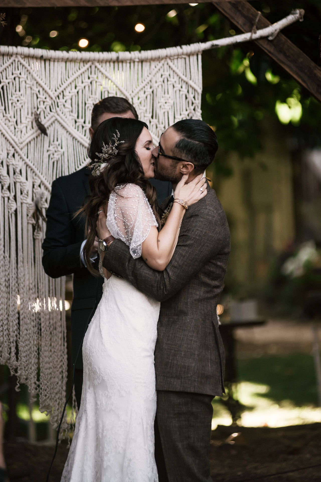 couple kisses for the first time as man and wife shot by wedding photographer at the charming St. George Hotel in Volcano California