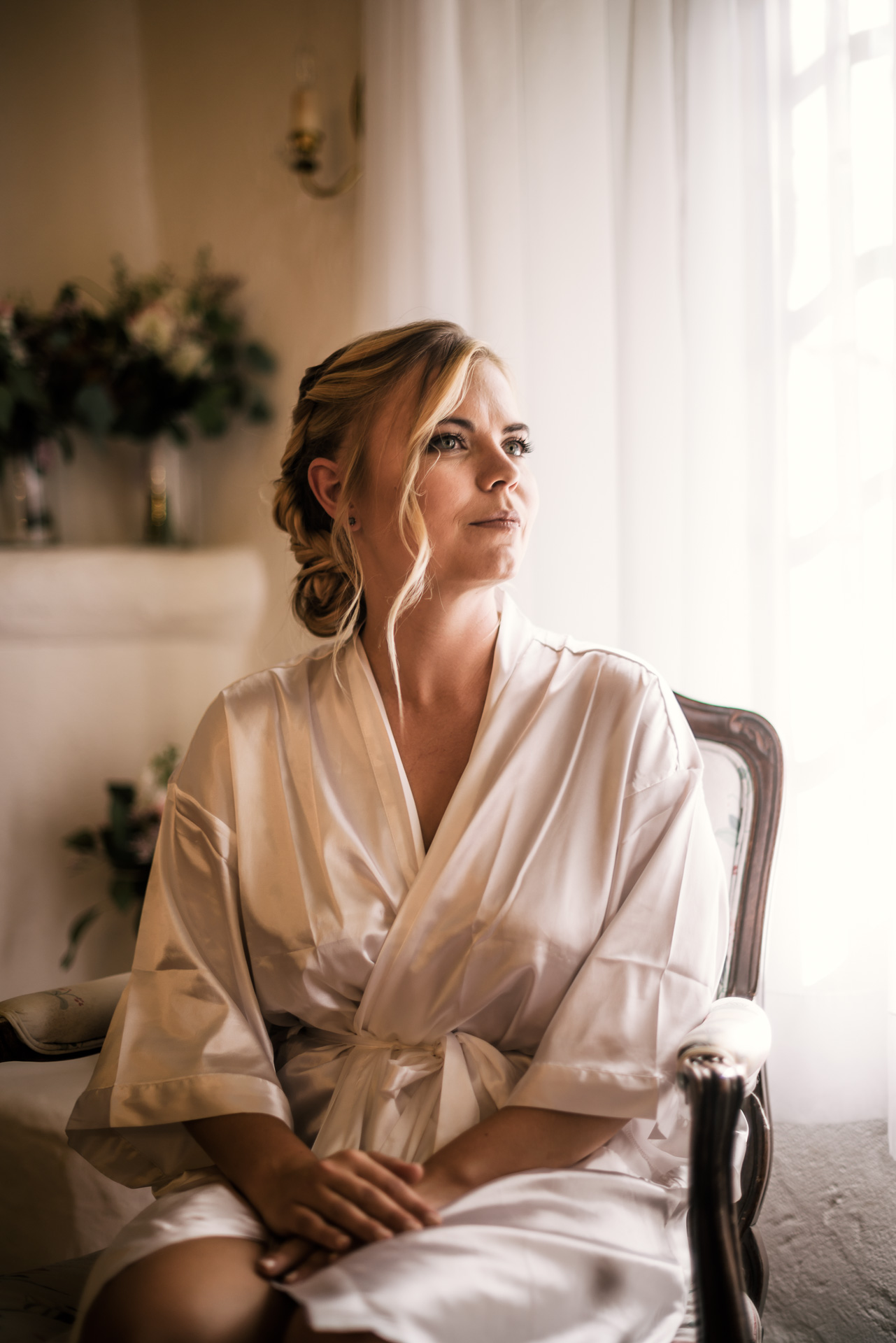 portrait of the bride before her big day lit with window light captured by photographer during romantic wedding at the historic Leo Carrillo Ranch in Carlsbad California