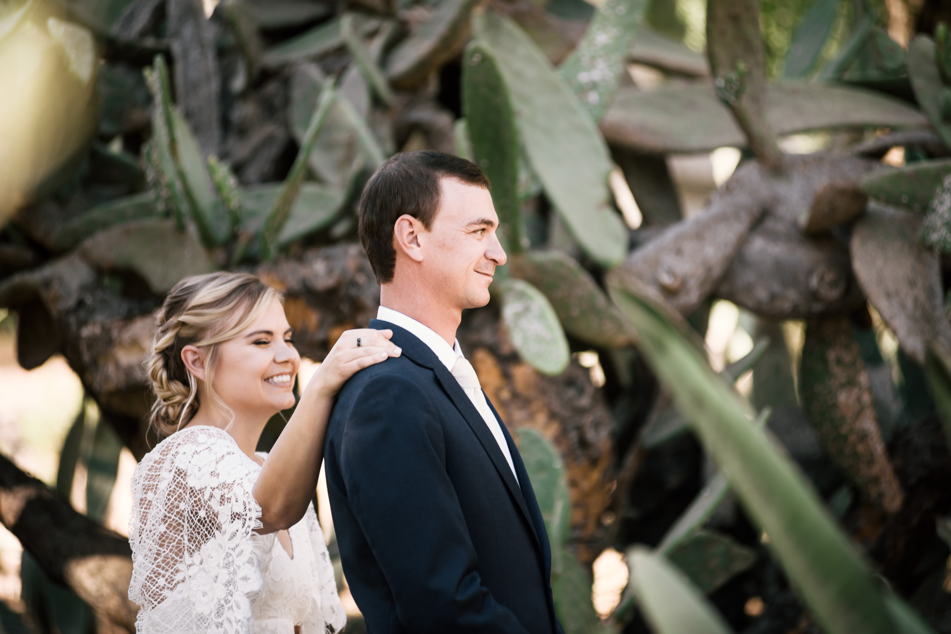 bride and groom are all smiles as they prepare to see each other for the first look captured by photographer during romantic wedding at the historic Leo Carrillo Ranch in Carlsbad California