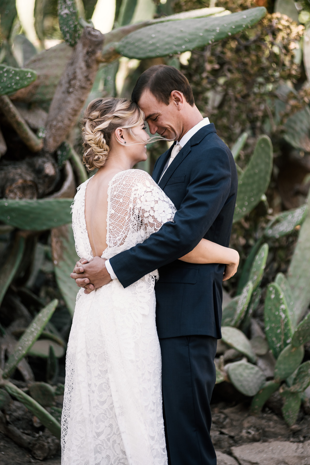 Tender moment between bride and groom as they get close captured by photographer during romantic wedding at the historic Leo Carrillo Ranch in Carlsbad California