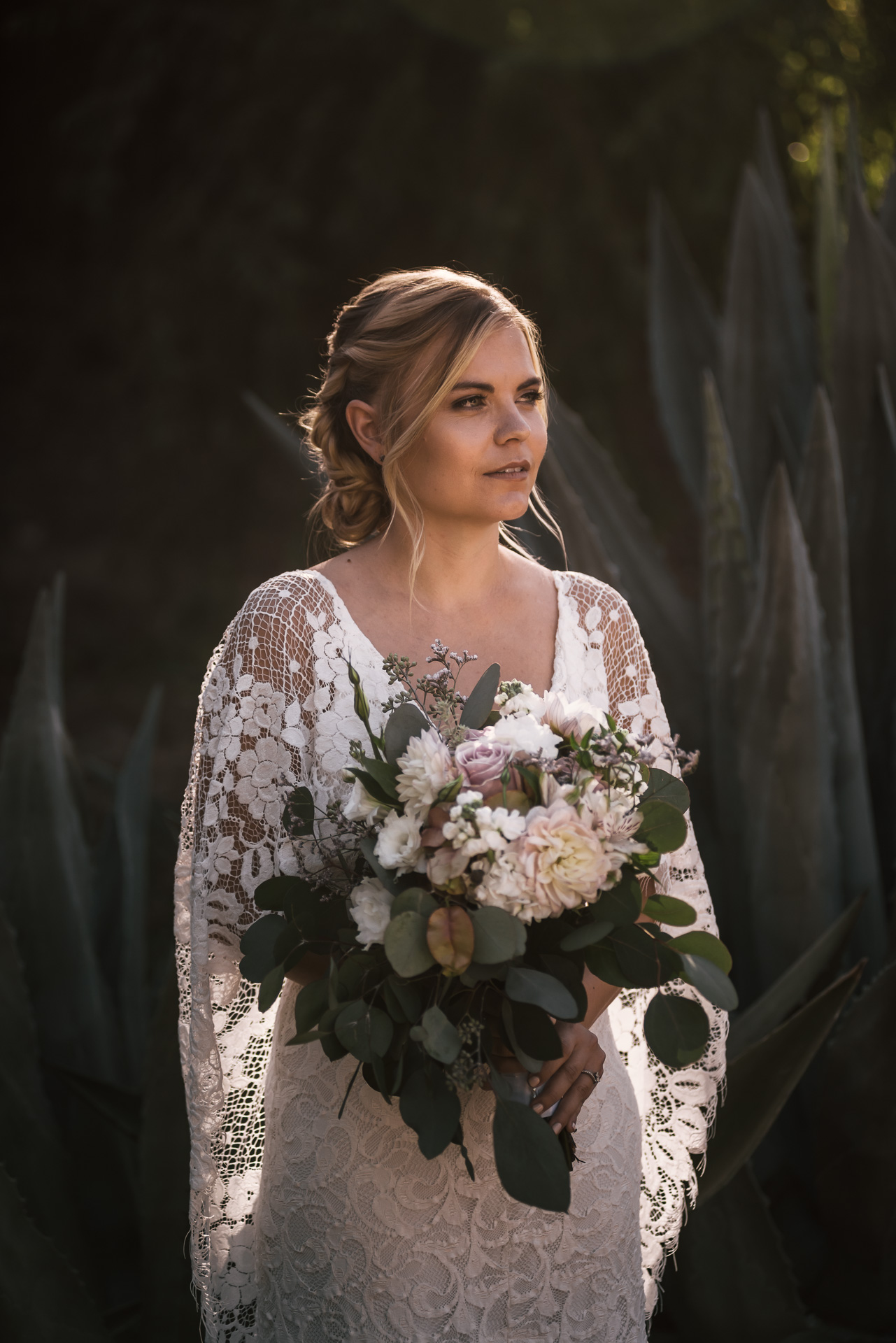 Beautiful bridal portait in front of agave plants captured by photographer during romantic wedding at the historic Leo Carrillo Ranch in Carlsbad California