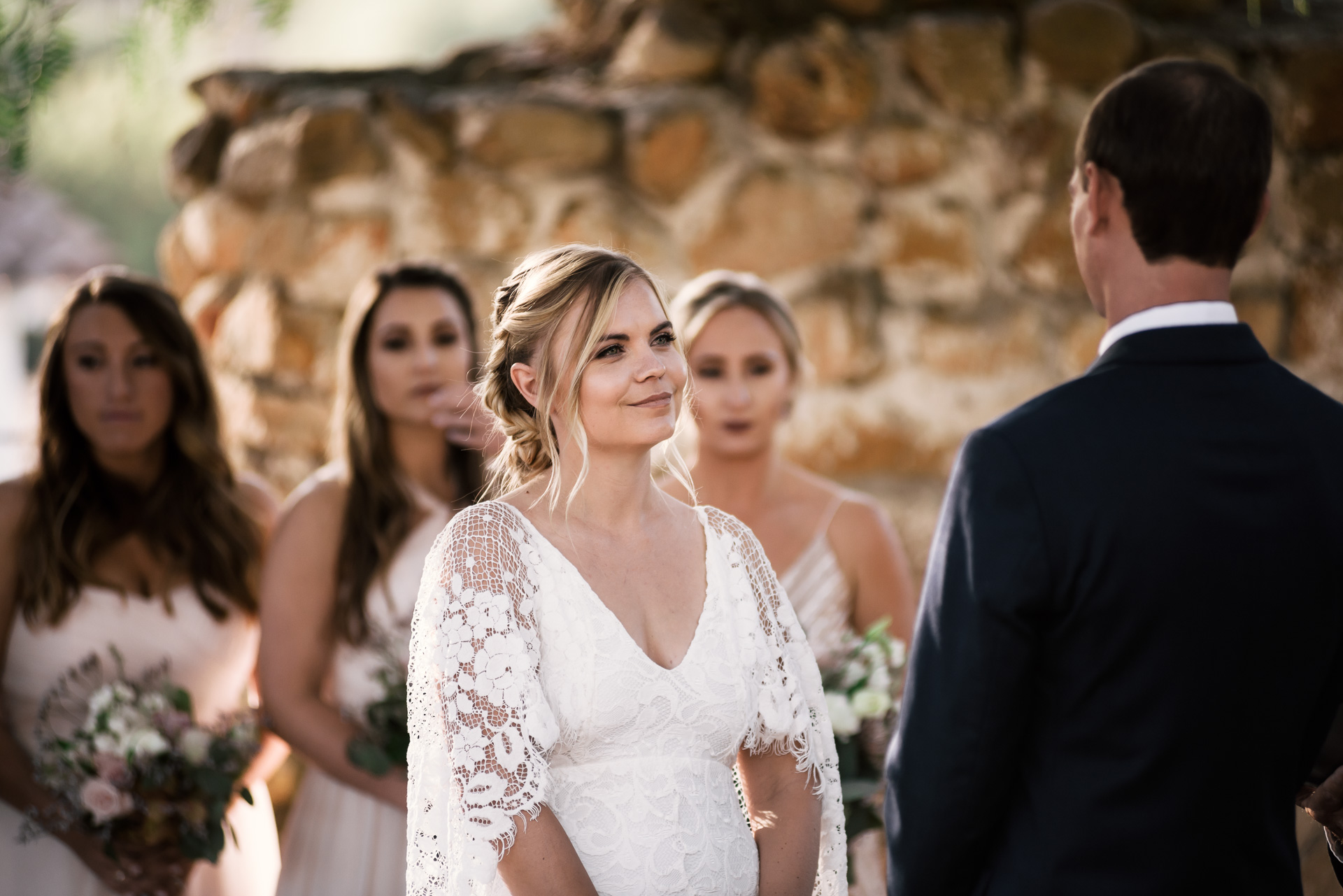 bride looks lovingly at her groom captured by photographer during romantic wedding at the historic Leo Carrillo Ranch in Carlsbad California