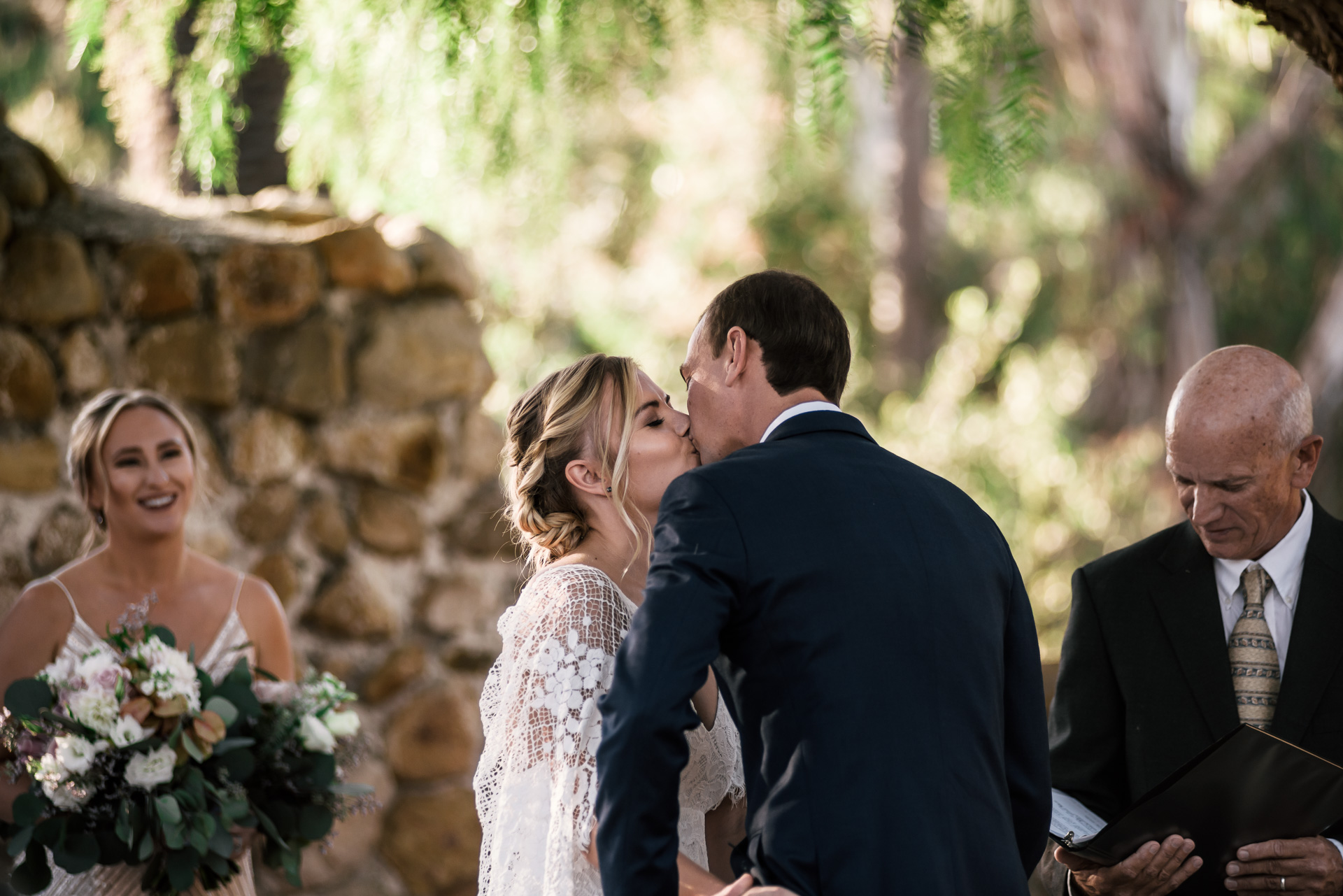 romantic first kiss captured by photographer during romantic wedding at the historic Leo Carrillo Ranch in Carlsbad California