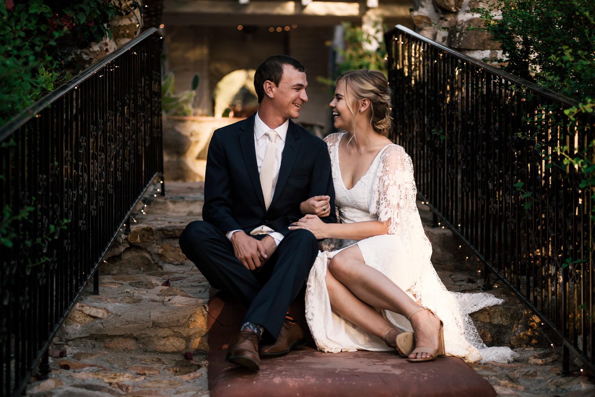 bride and groom sit for a moment and enjoy each others company captured by photographer during romantic wedding at the historic Leo Carrillo Ranch in Carlsbad California