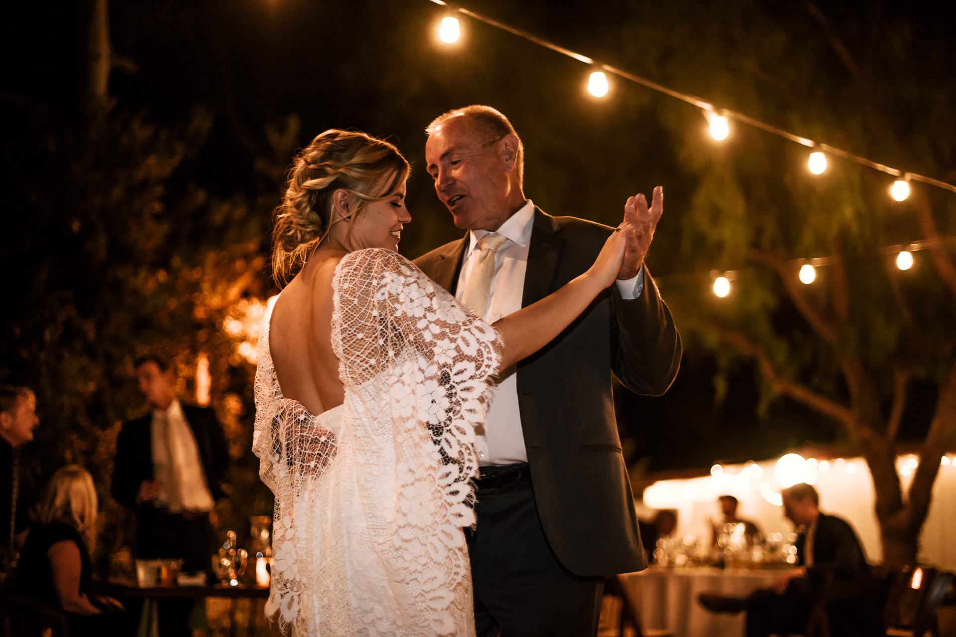 Father dances with bride captured by photographer during romantic wedding at the historic Leo Carrillo Ranch in Carlsbad California