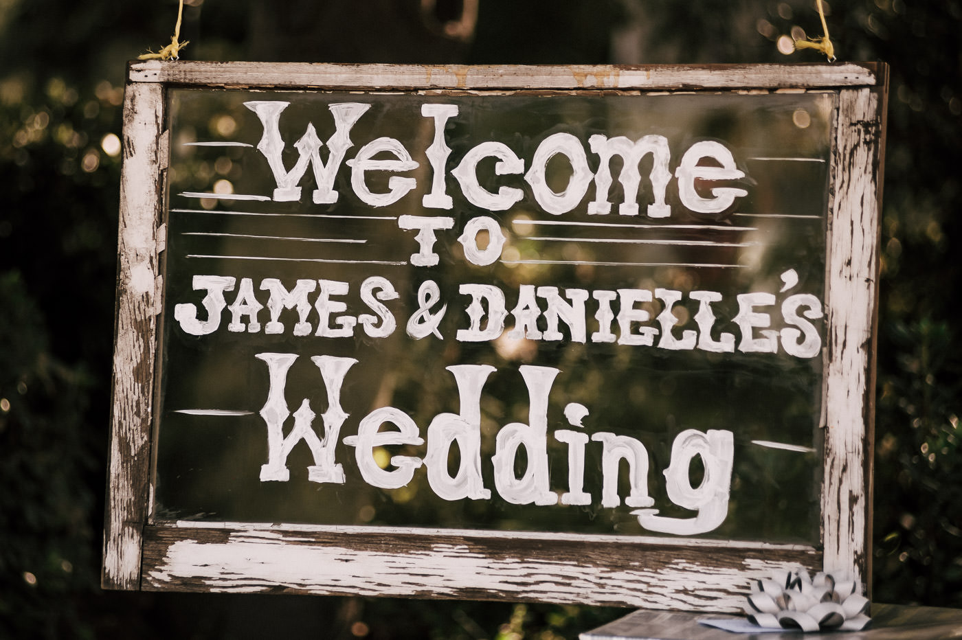 Rustic wood wedding sign welcoming guests to wine country wedding in Temecula
