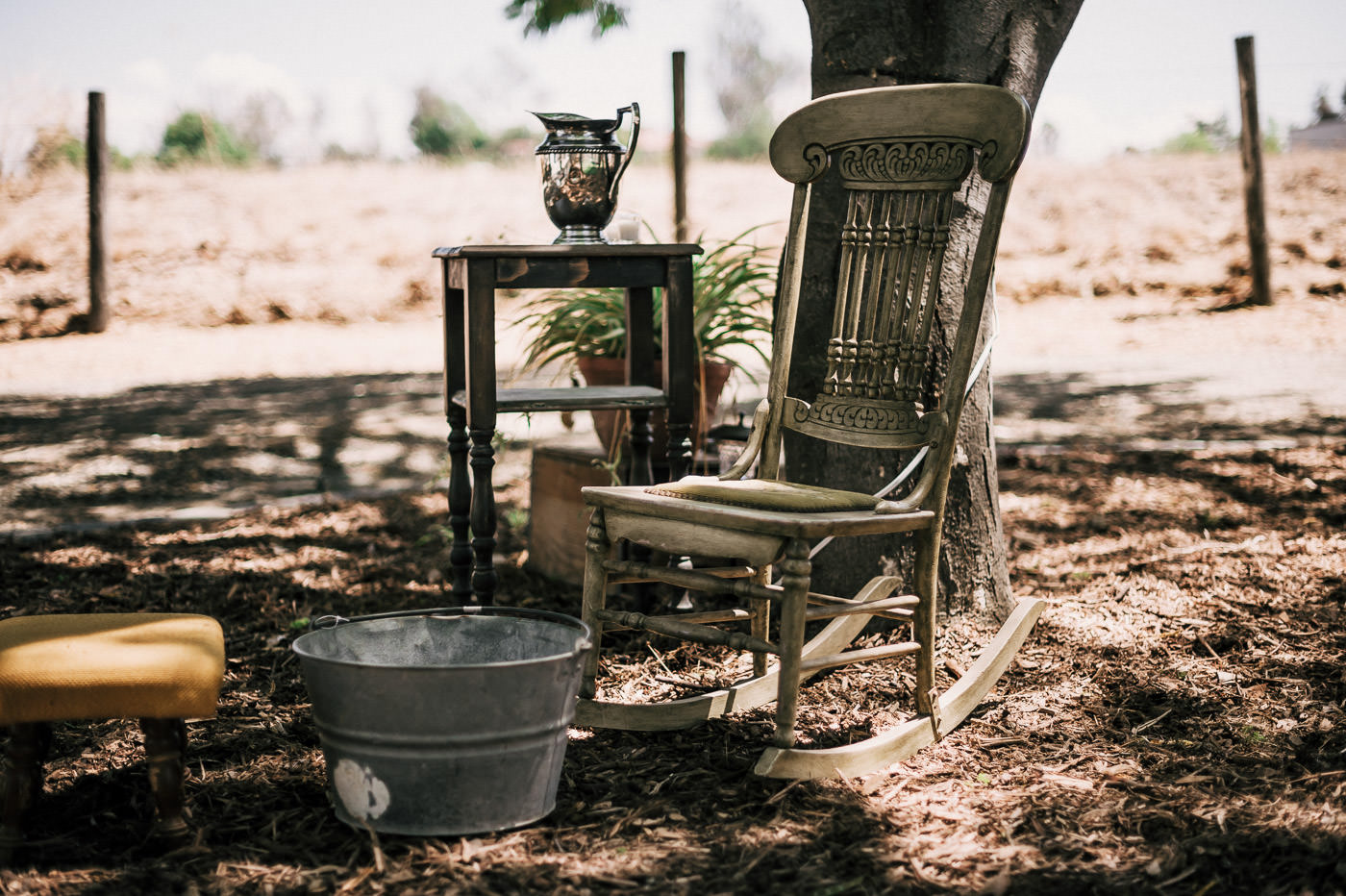 Vintage Rocking chair and metal basin for christian foot washing ceremony at Temecula wine country wedding