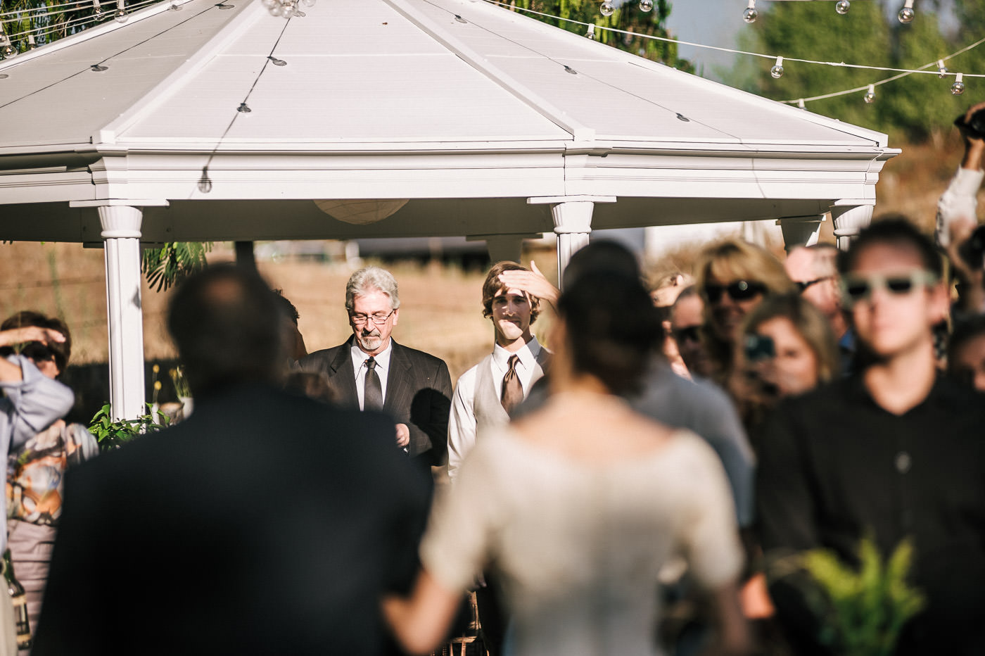 Groom sees the love of his life for the first time coming down the aisle at their romantic wine country wedding in Temecula california