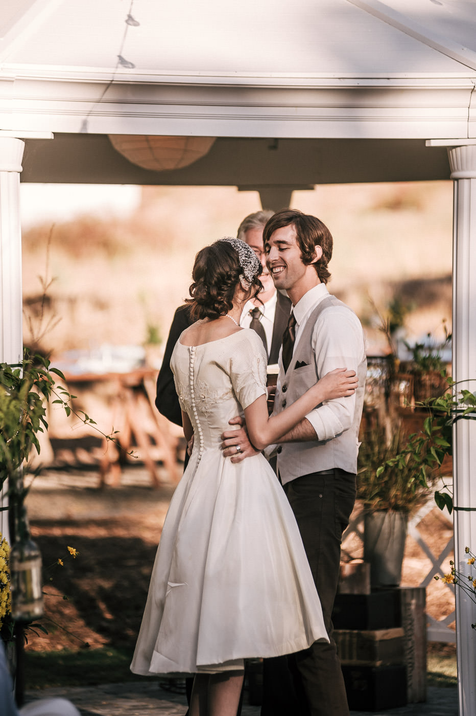 Newly married couple smiles and prepares to have their first kiss at Temecula wine country wedding