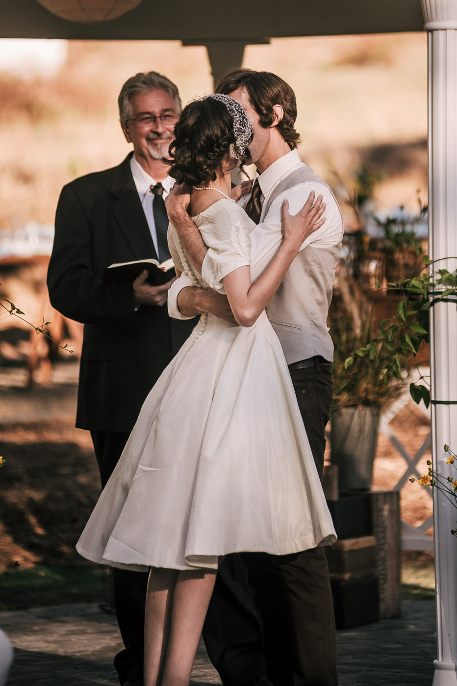 Bride and groom share a romantic kiss for the first time at their temecula wine country wedding
