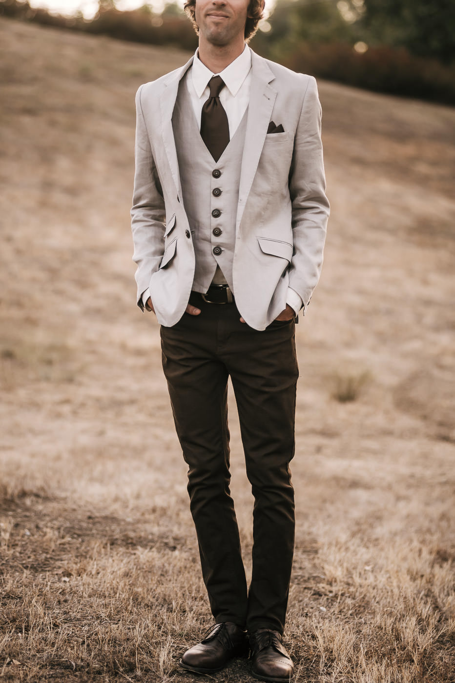 Grey coat and vest with brown slacks and details makes for fantastic vintage wedding style