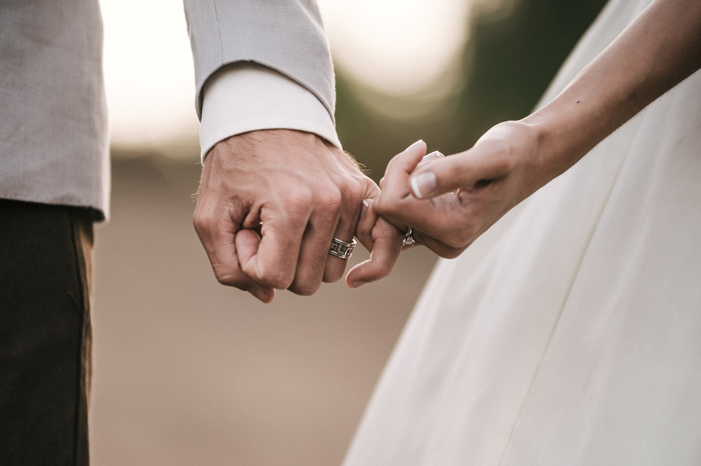 Bride and groom pinky promise to love each other forever