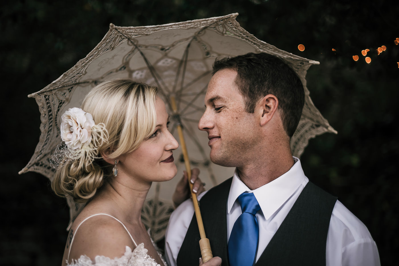 romantic wedding photographer takes intimate portraits of a loving couple at their whispering oaks terrace wedding in temecula california