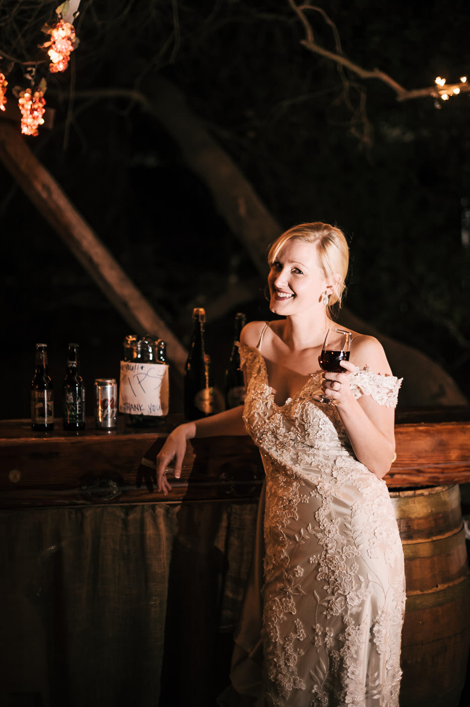bride hits the bar for some refreshments after a long but beautiful wedding