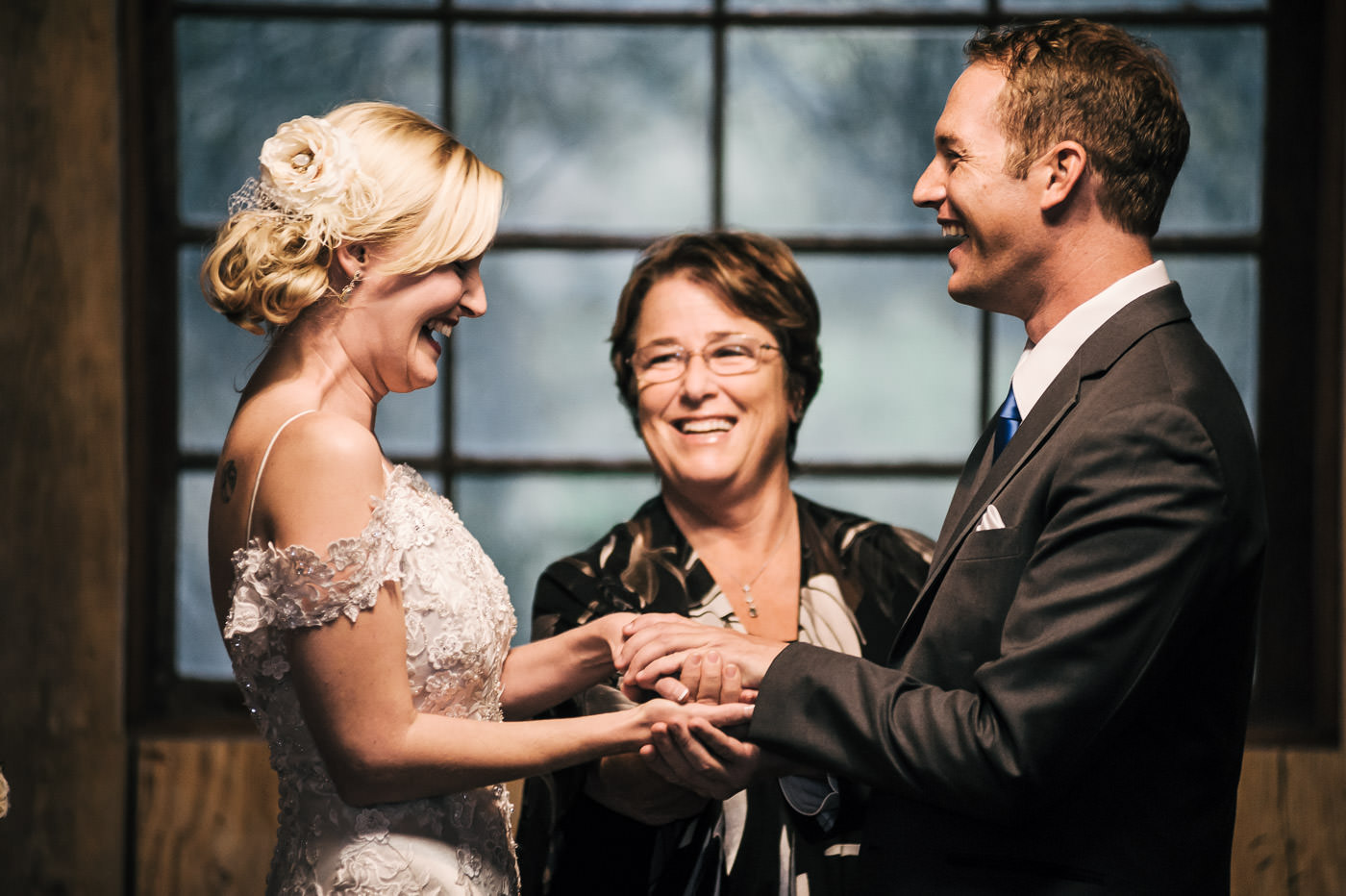 best wedding photograper in temecula california captures a couples sweet laugh during their ceremony at whispering oaks terrace