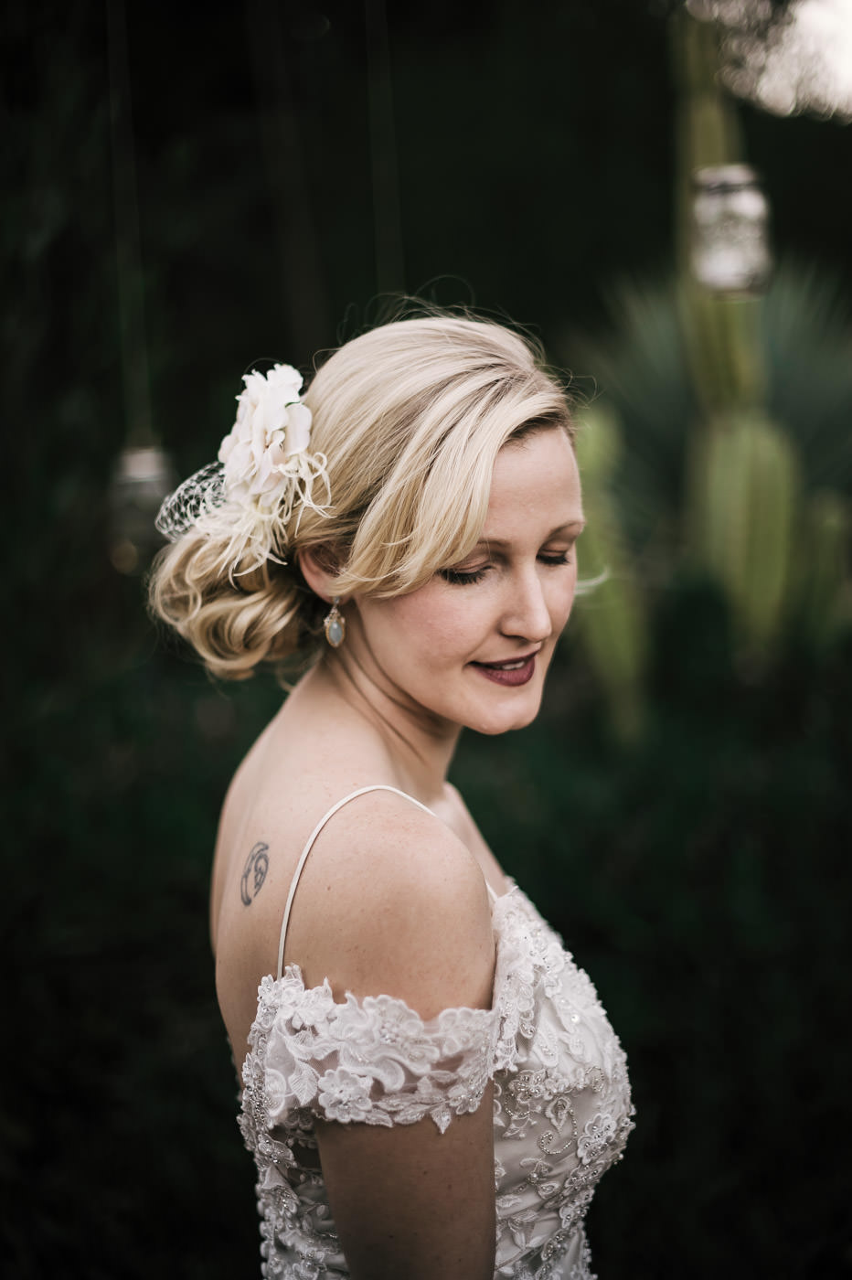 gorgeous vintage styled bride poses for portraits before her wedding at the whispering oaks terrace venue.