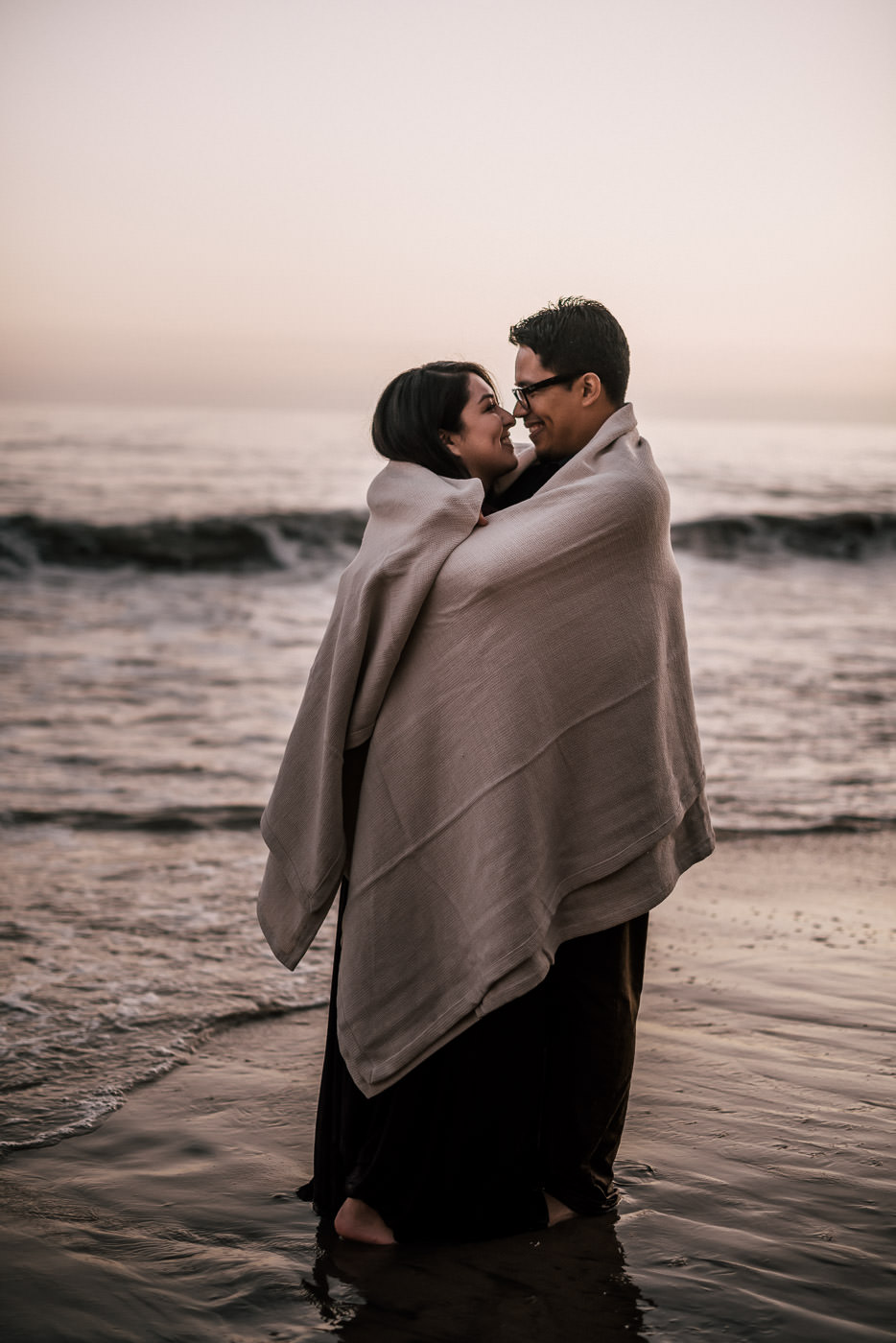 The cold winter weather couldnt deter this romantic couple from having their engagement session on the wet sand of El Matador State Beach.