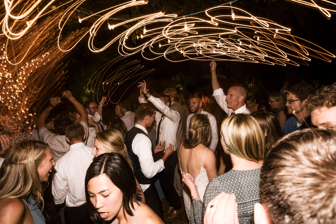 Wedding photographer artistically captures the fun of the reception after the wedding in Temecula California