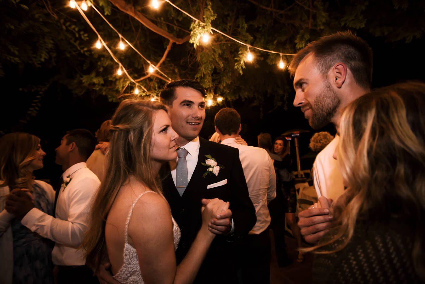 Couples hit the dance floor for a roamntic slow dance and chat with the bride and groom.