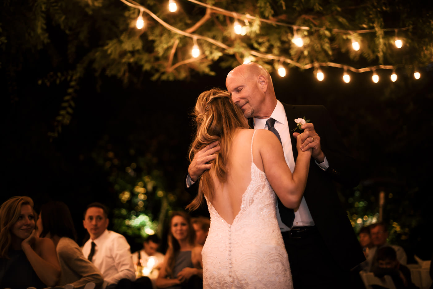 Father is overcome with emotion as he dances with his daughter at the recpetion after a romantic Temecula Wedding.
