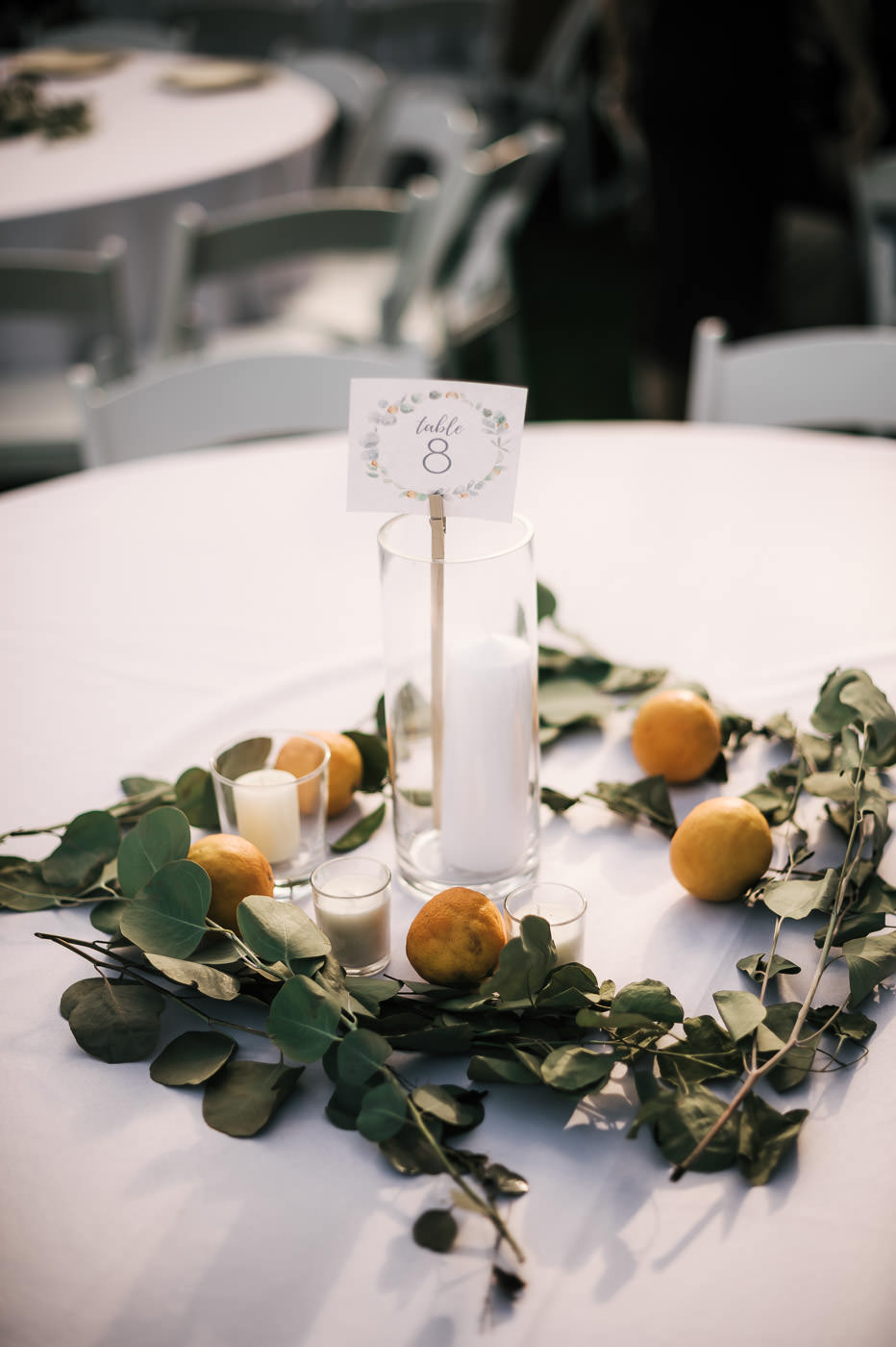 Oranges and tree branches make the perfect table setting for a wedding in the orchards of Temecula California.
