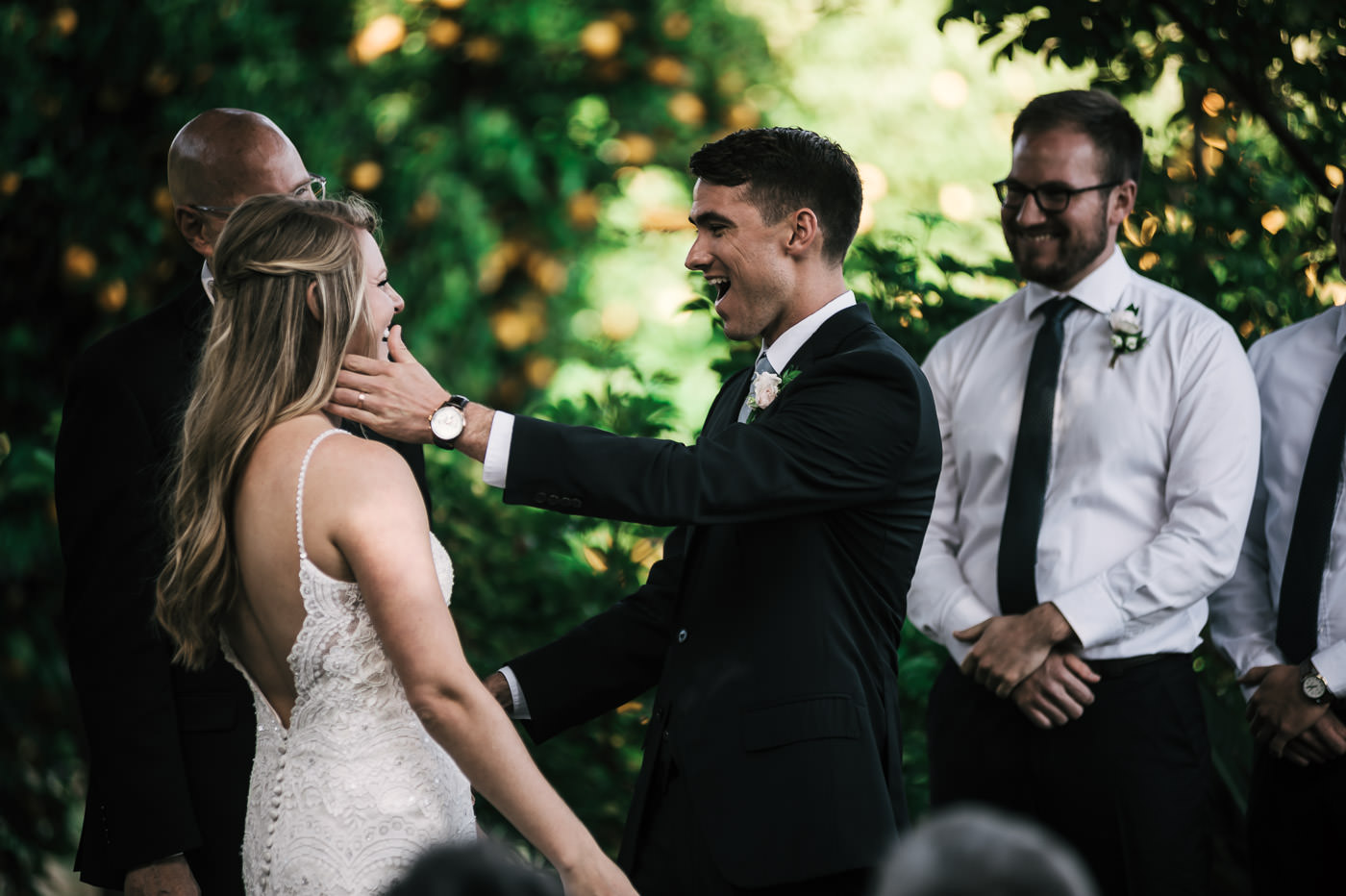 Take a look at these two's absolute joy as they prepare to have their first kiss as husband and wife. The orange orchard behind makes the perfect backdrop for this Temecula Wedding.